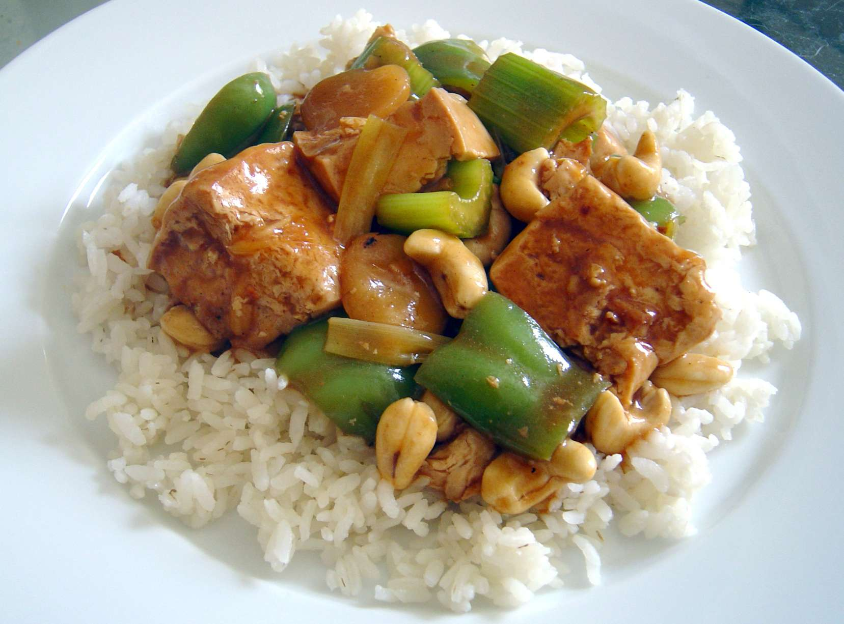 """Tofu cashew """"chicken"""" over white rice"""