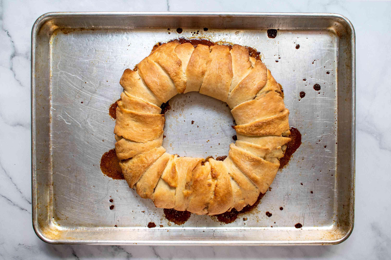 baked vegan king cake on a baking sheet