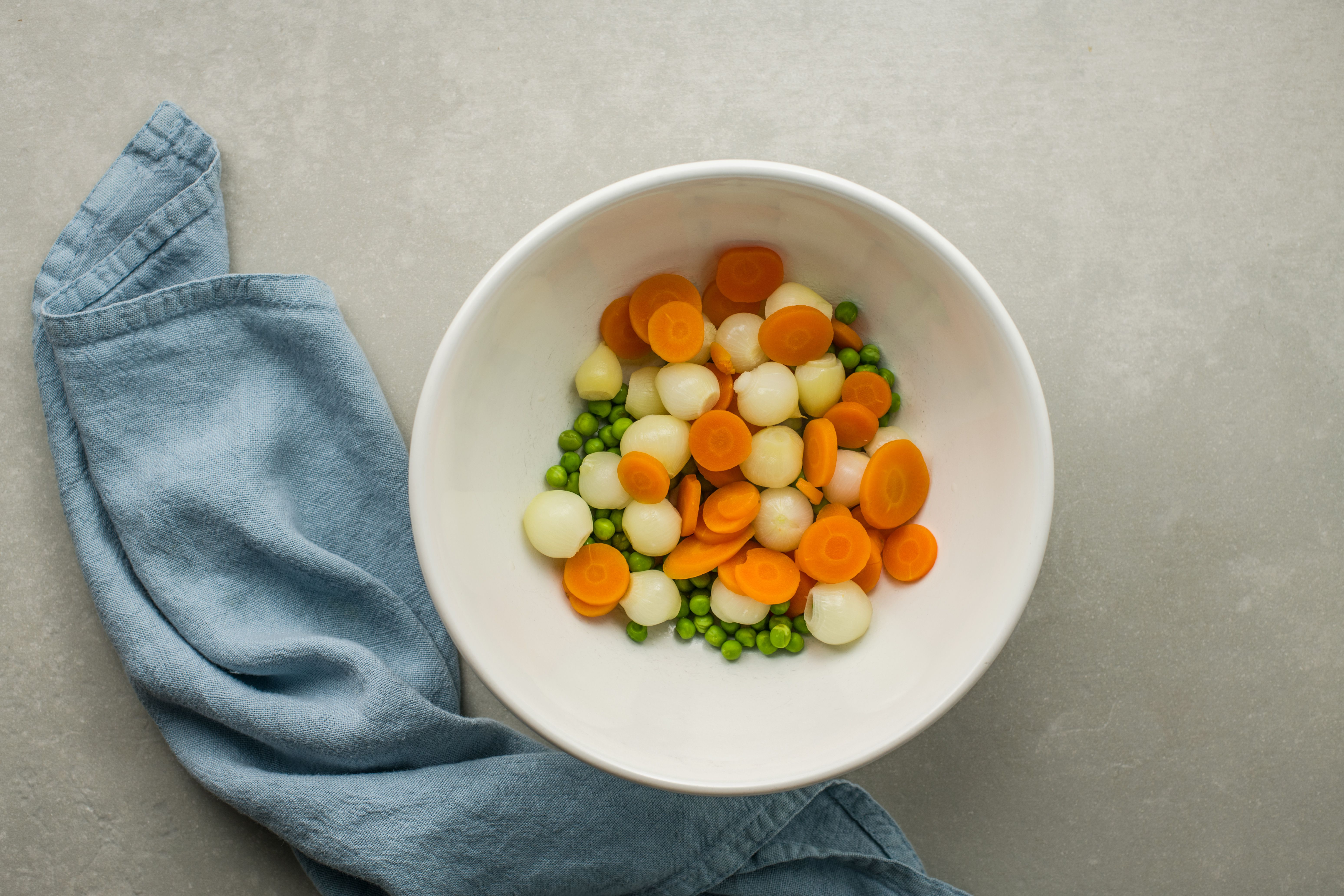 Drained and cooked peas, carrots, and pearl onions