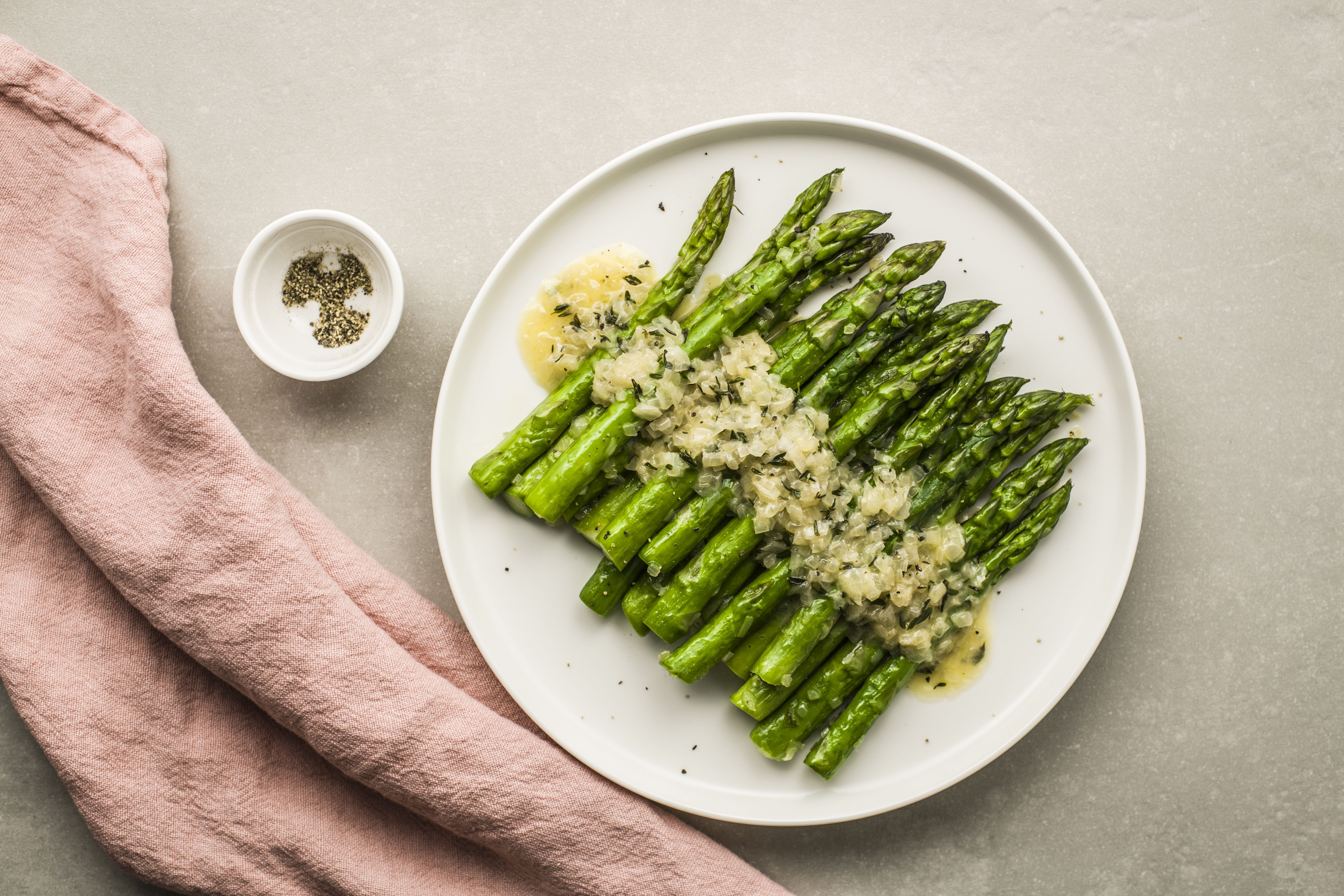 Pour over cooked asparagus