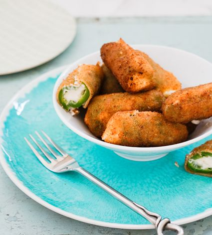 Jalapeño poppers in a bowl set on a plate