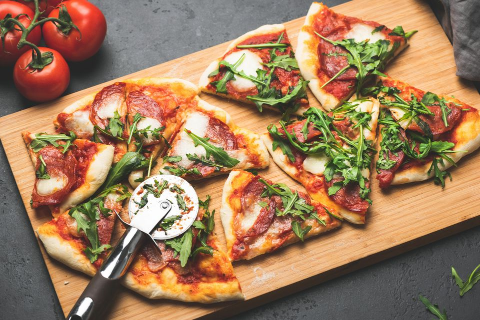 Pizza or flatbread with arugula, salami, cheese