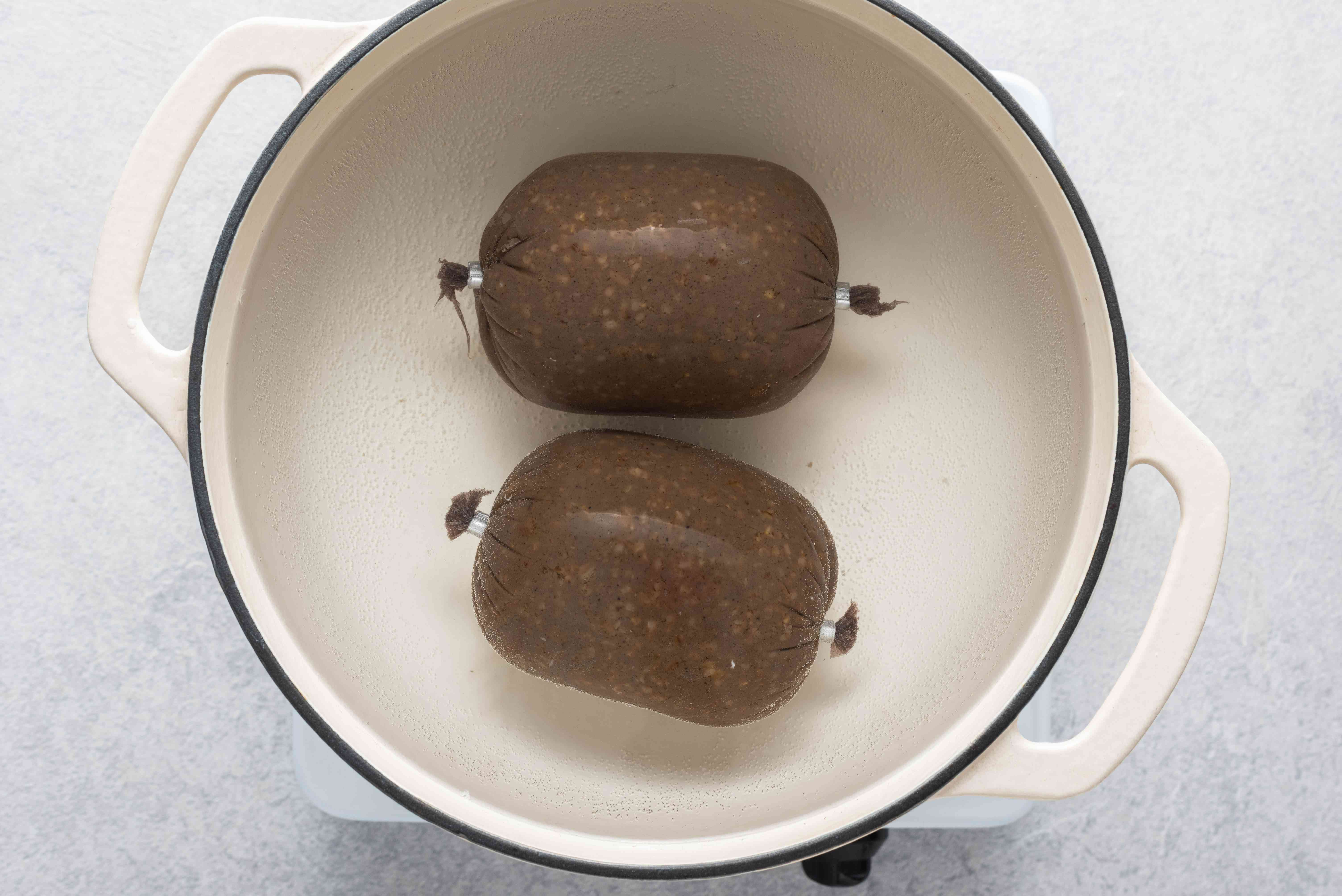 boiling the haggis in a pot with water
