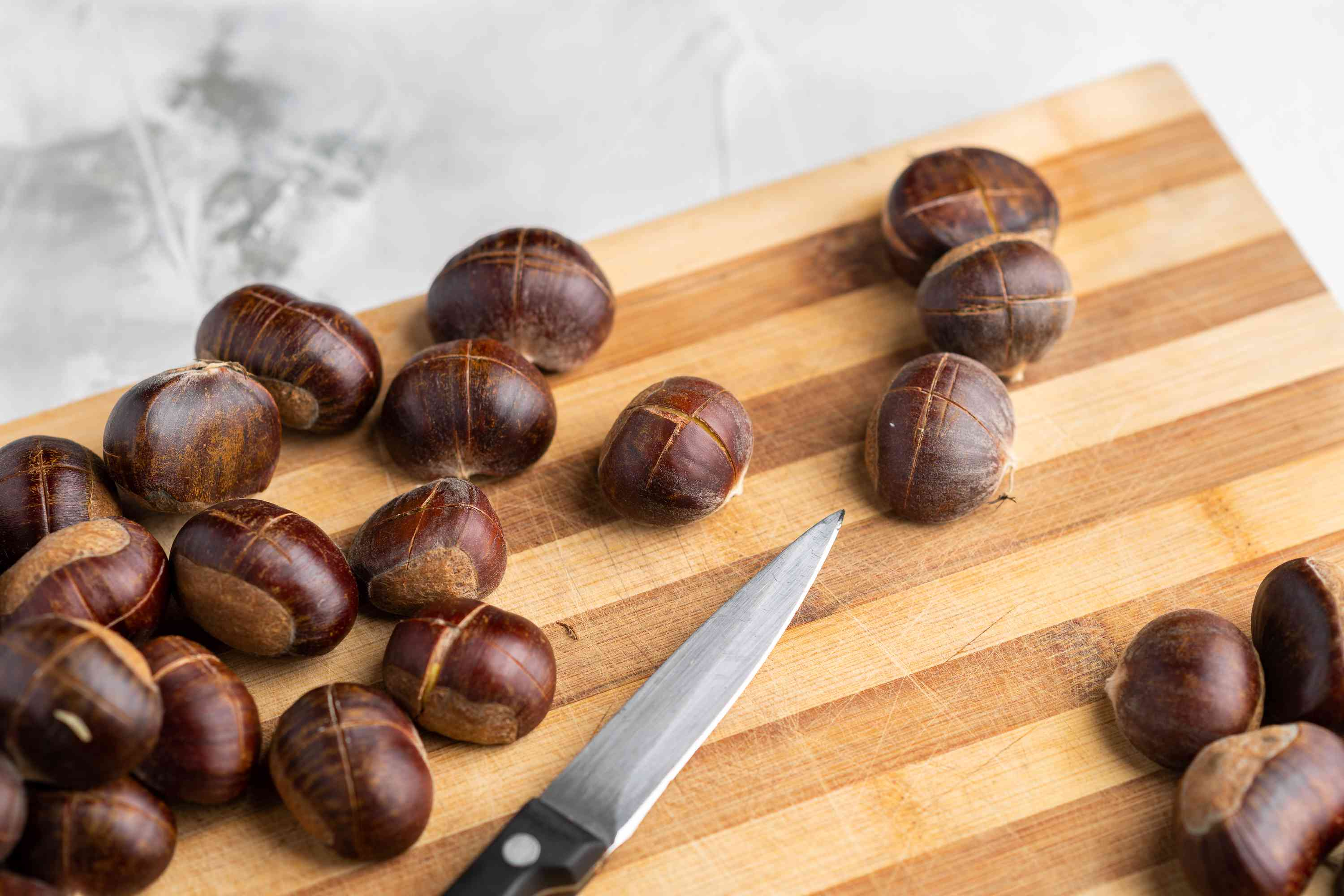 The top of each chestnut gets a knife-sliced