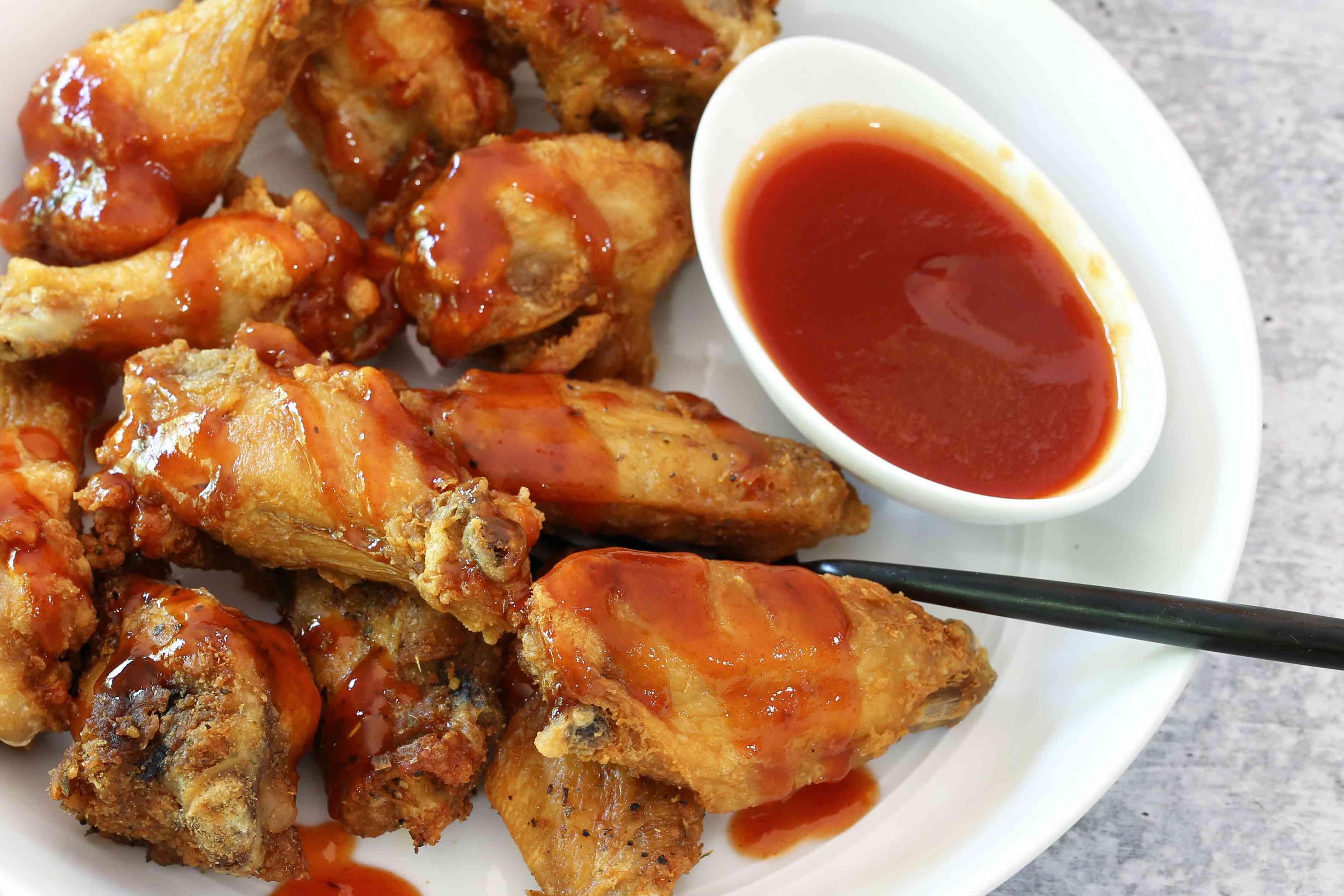 Mambo sauce or mumbo sauce with chicken wings.