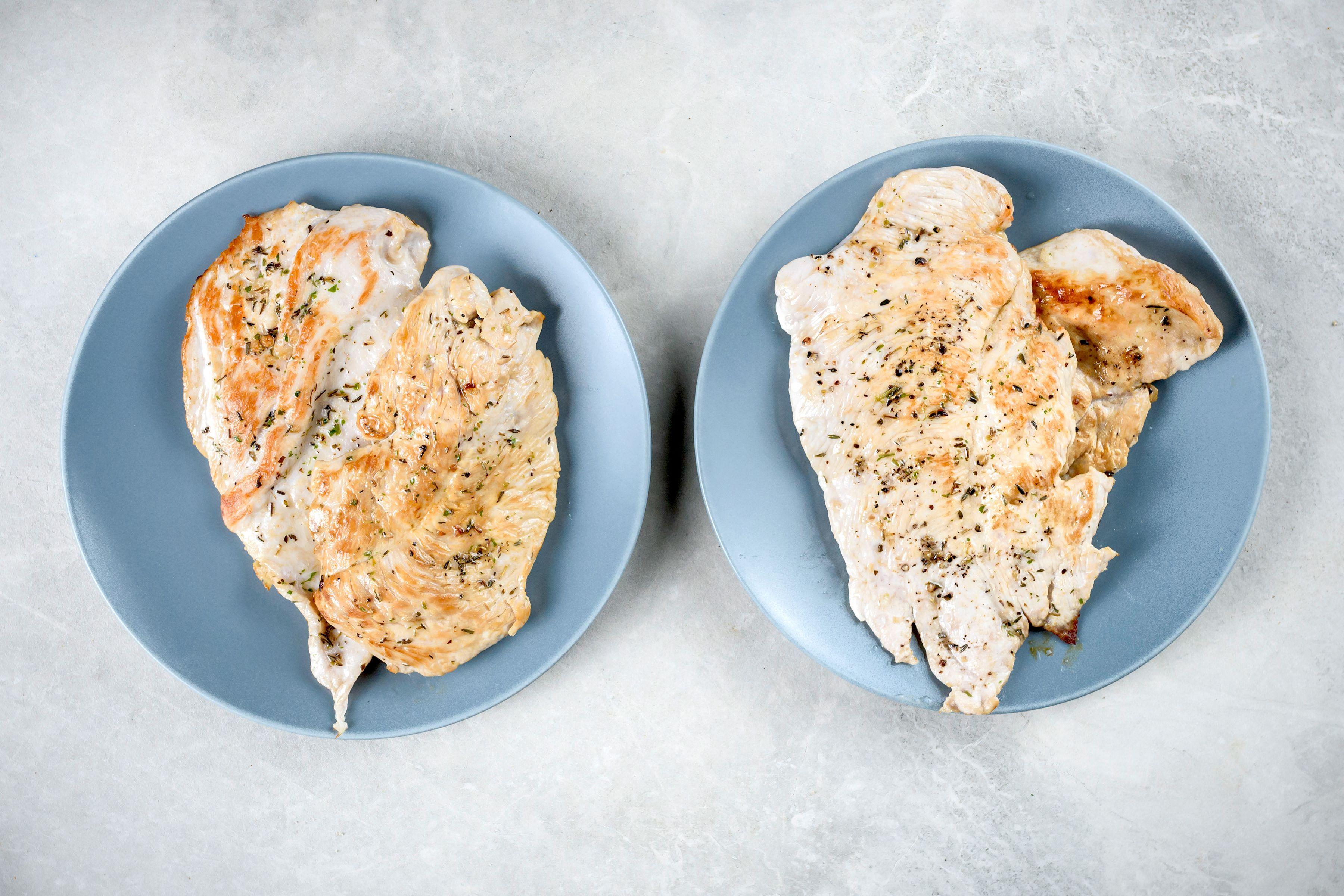 Seared turkey breasts on plates