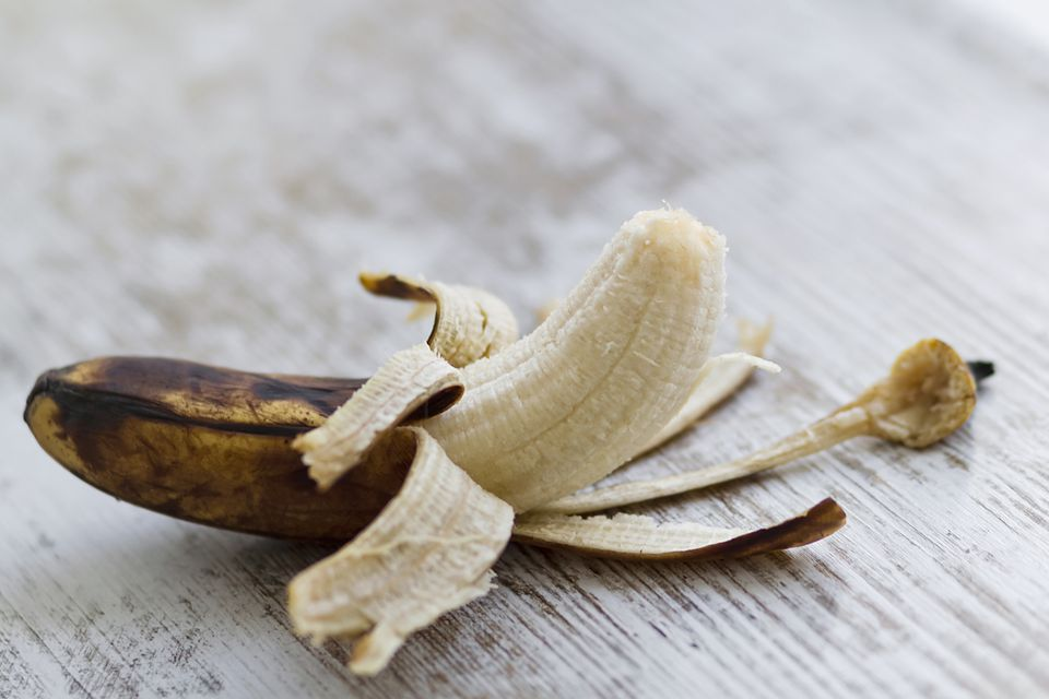 A very ripe banana over a rustic background