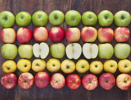 Fresh whole and cut apples