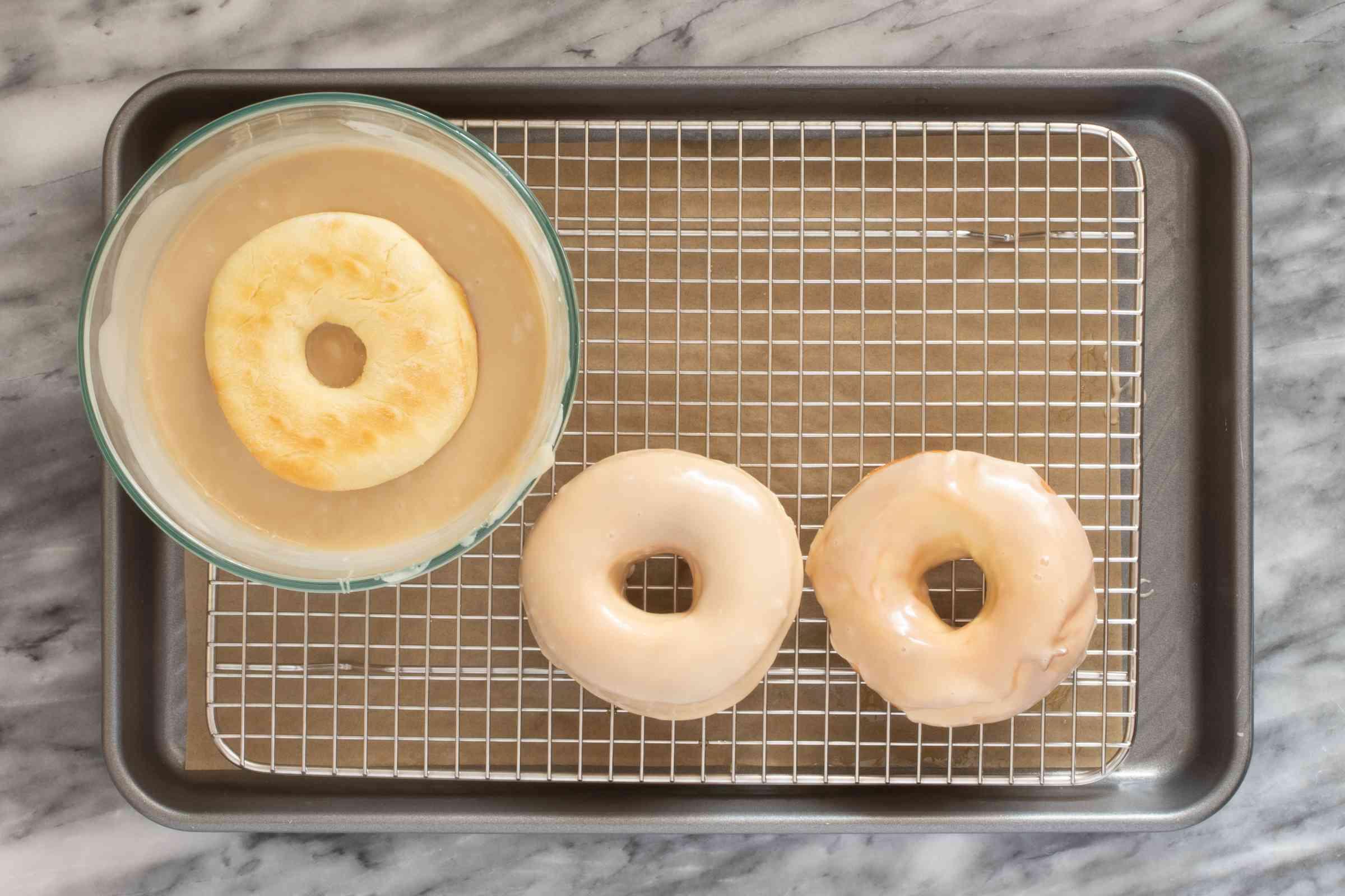 Glazing warm doughnuts