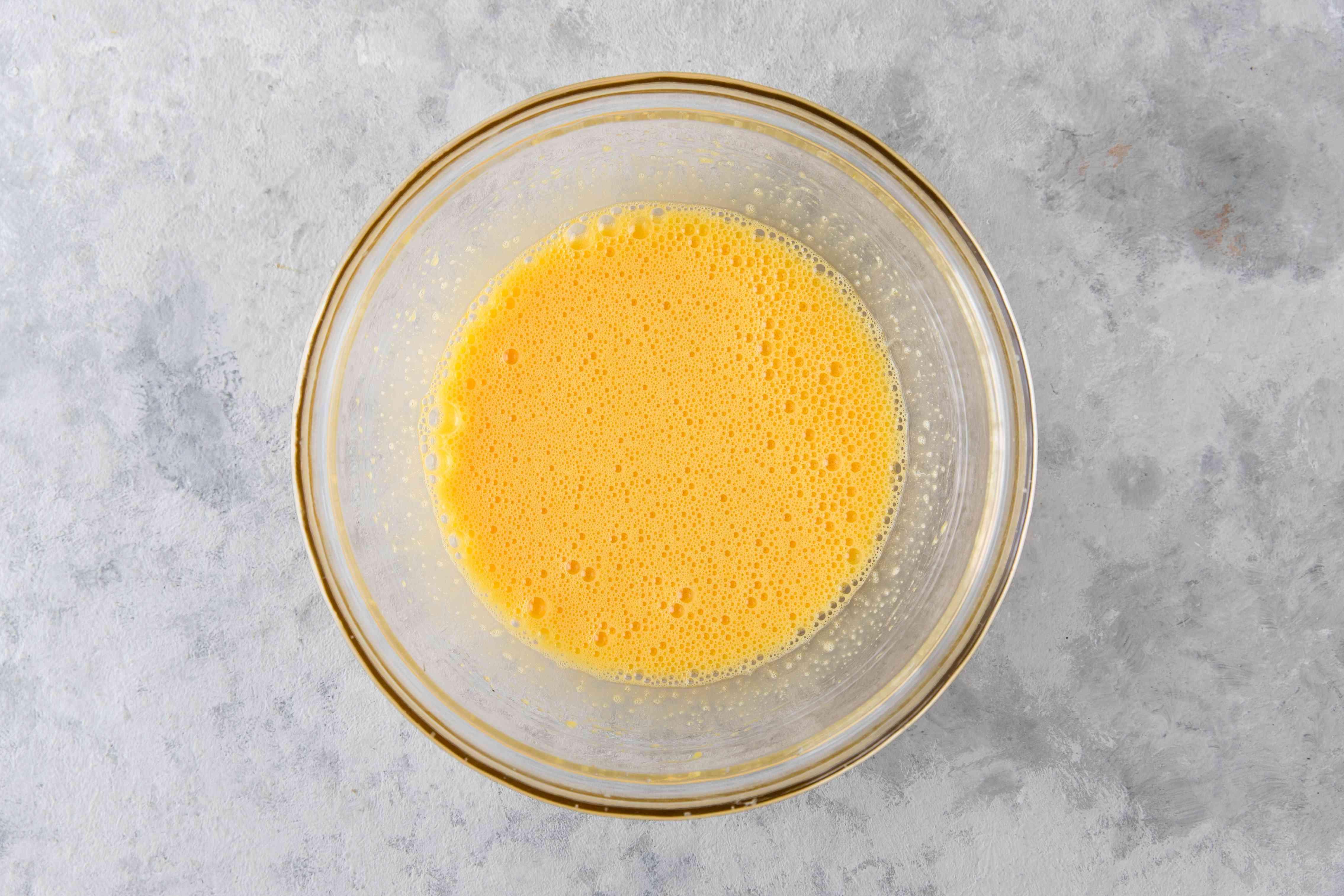 Whisk egg yolks
