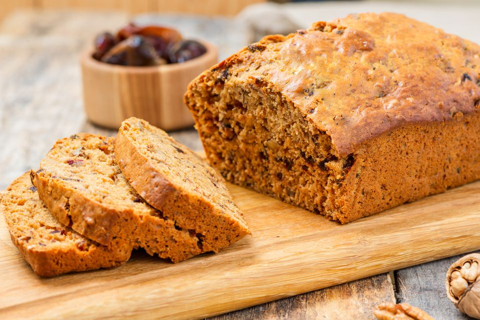 Date nut bread on wooden cutting board