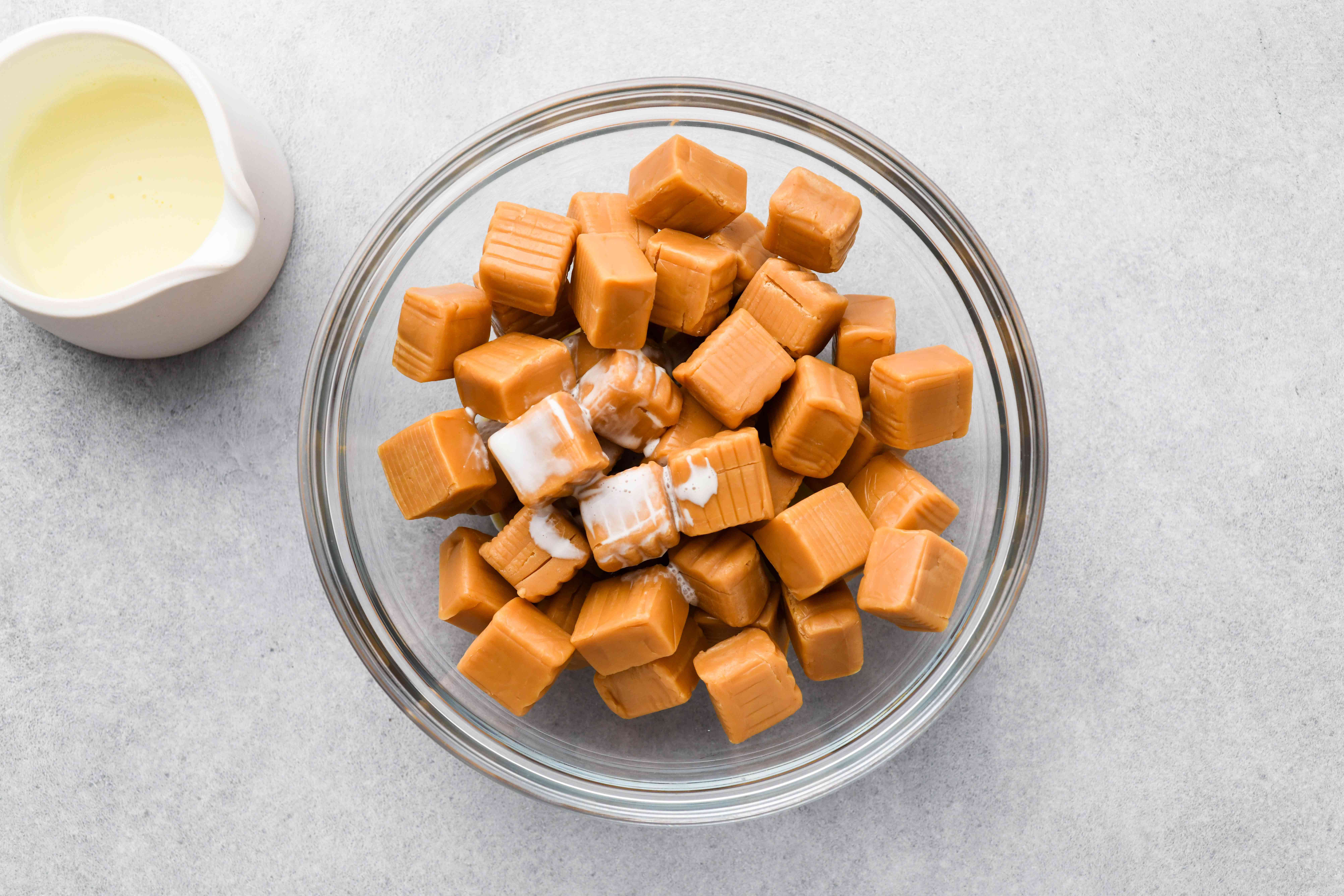 Combine the unwrapped caramels and cream in a bowl
