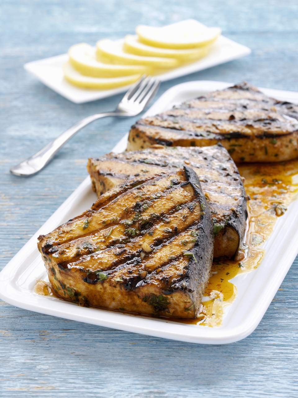 Grilled swordfish steaks, close up