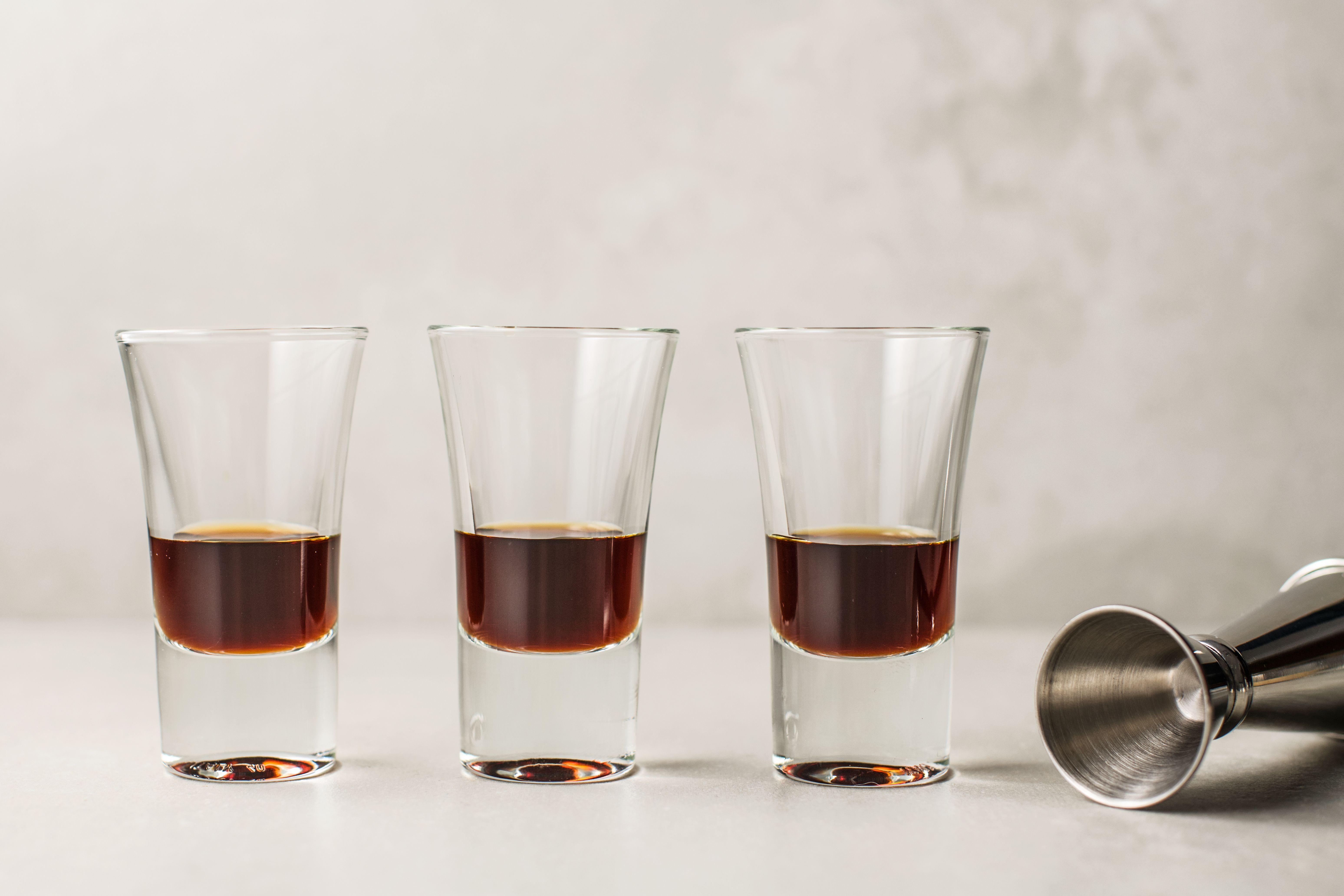 Coffee liqueur in three shot glasses