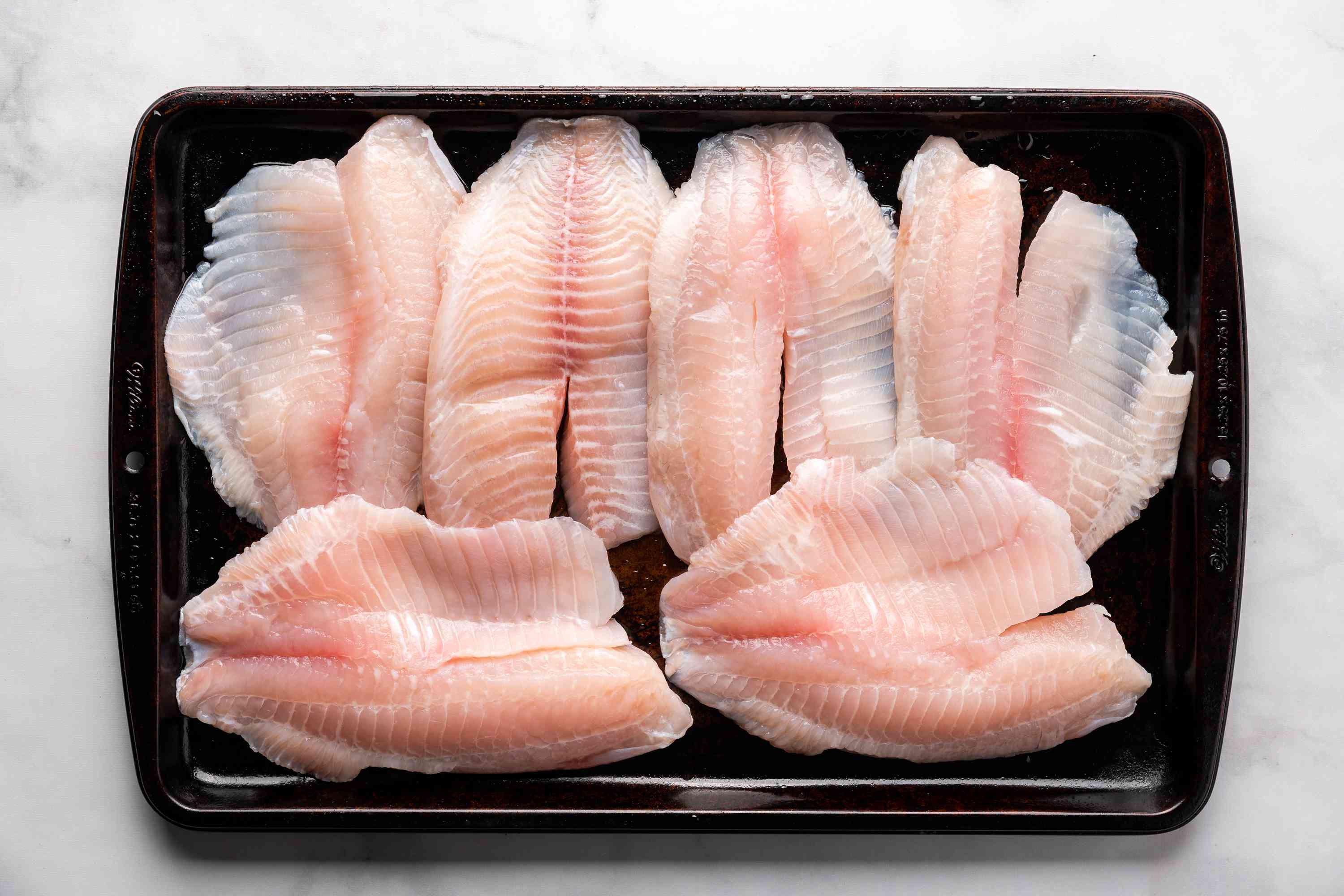 Wash the fish and remove all the bones, place on baking sheet