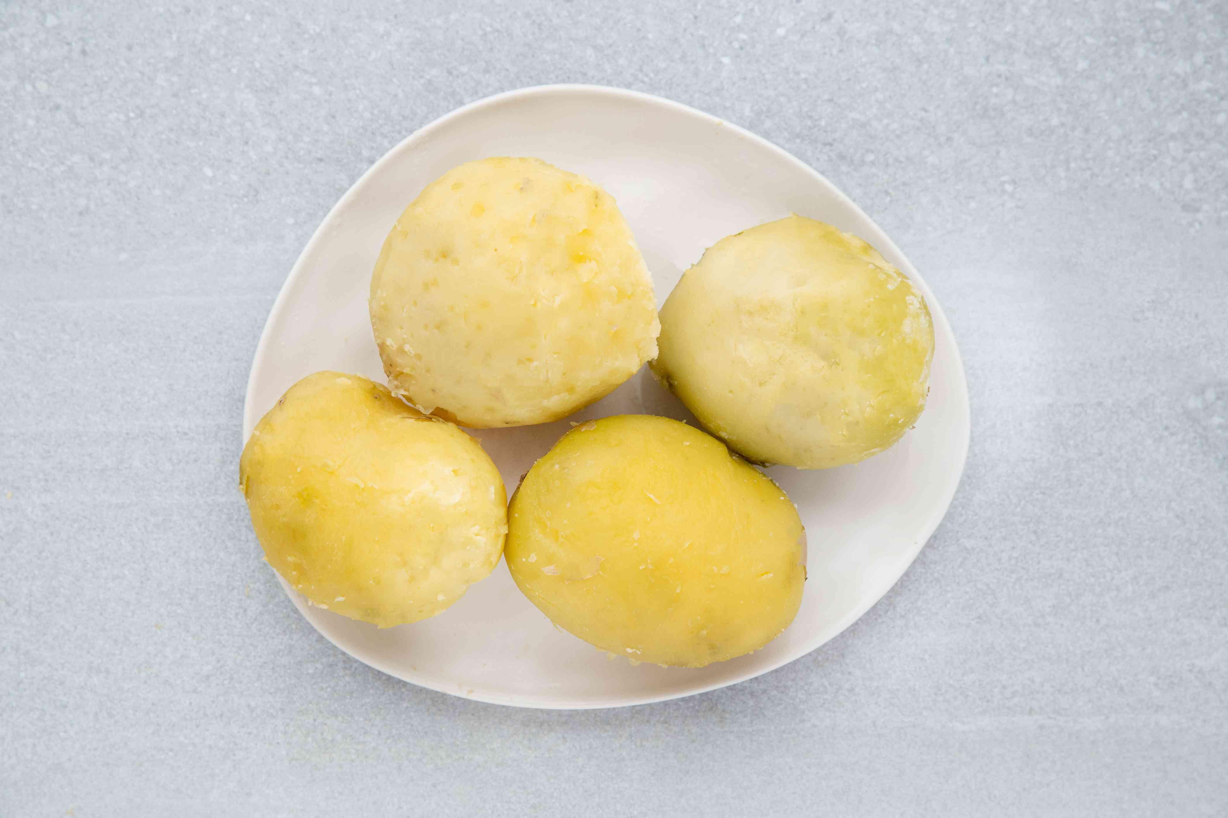 peeled potatoes on a plate