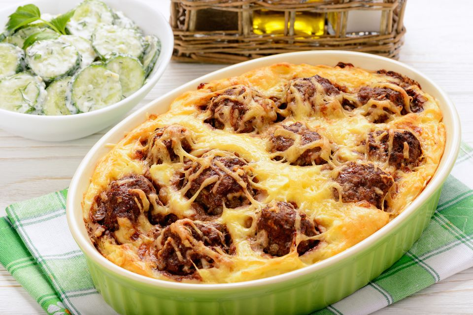 Casserole with vegetables, meatballs and cheese.