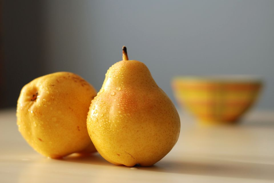 fresh pears on table