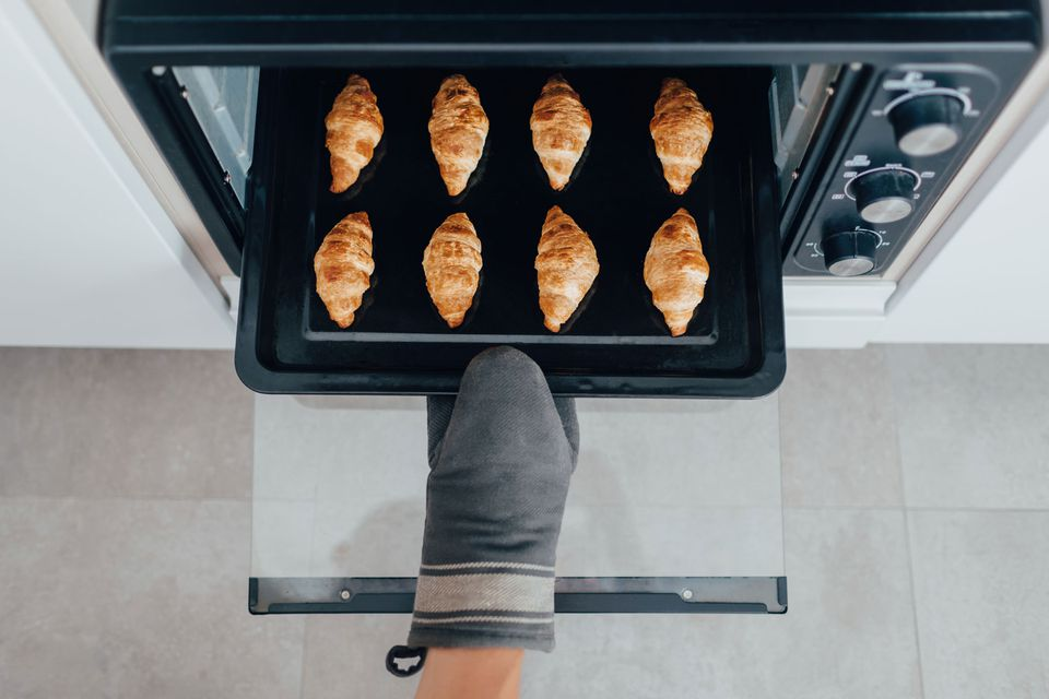 Taking croissants out of the oven
