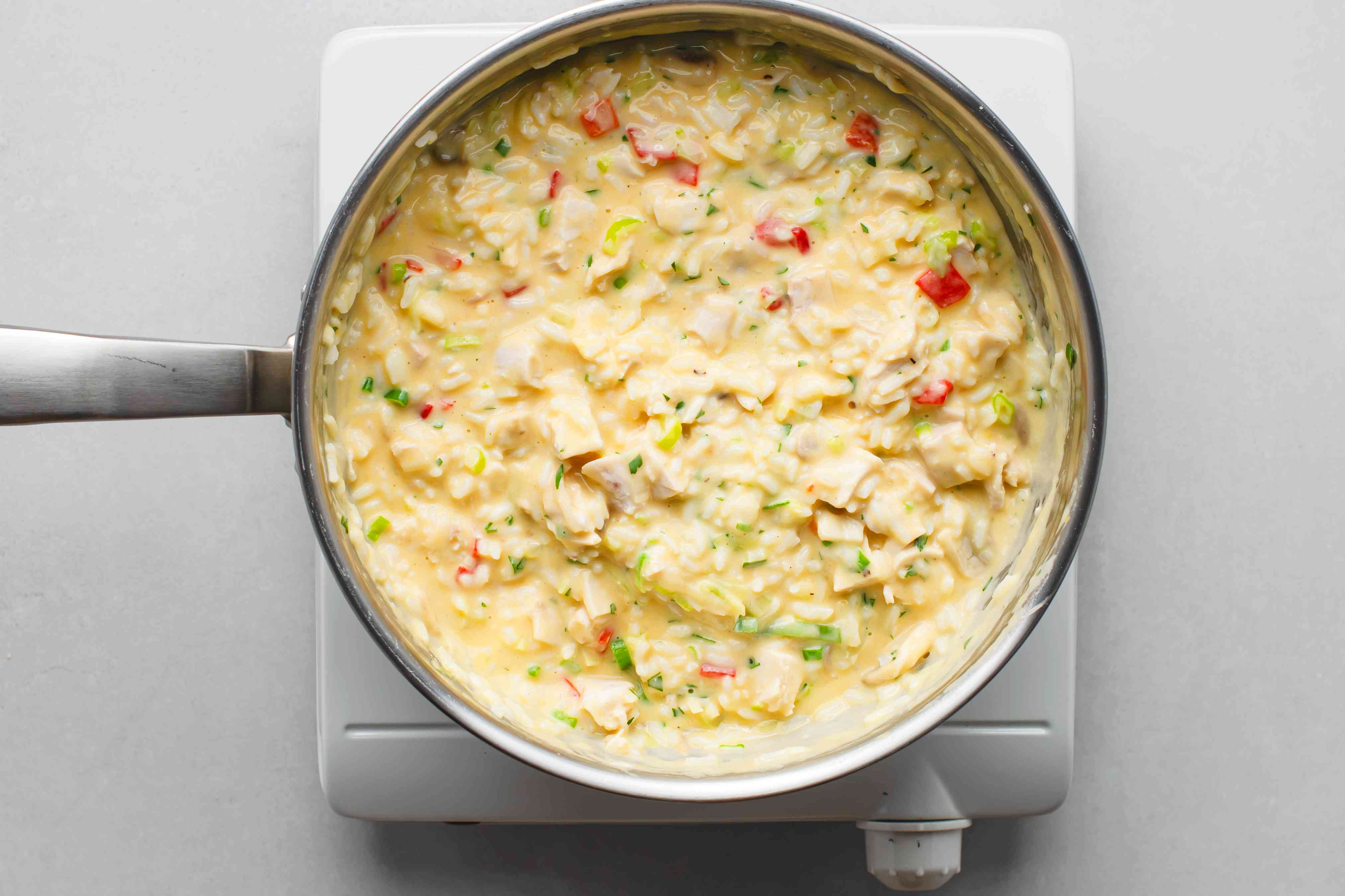 rice, chicken, and parsley added to the cheese sauce