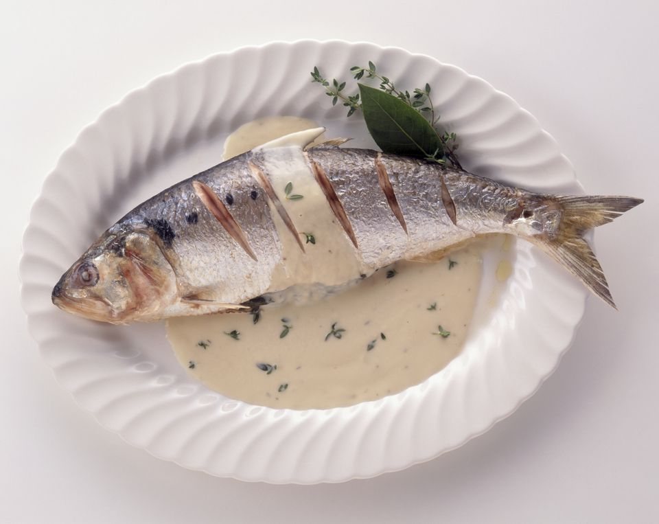 Grilled whole shad served with creamy sorrel sauce sprinkled with fresh thyme