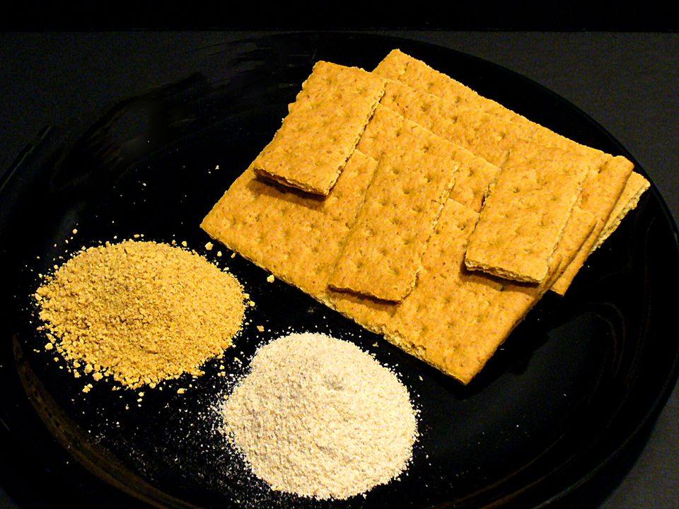A plate of graham crackers, crumbs, and graham flour