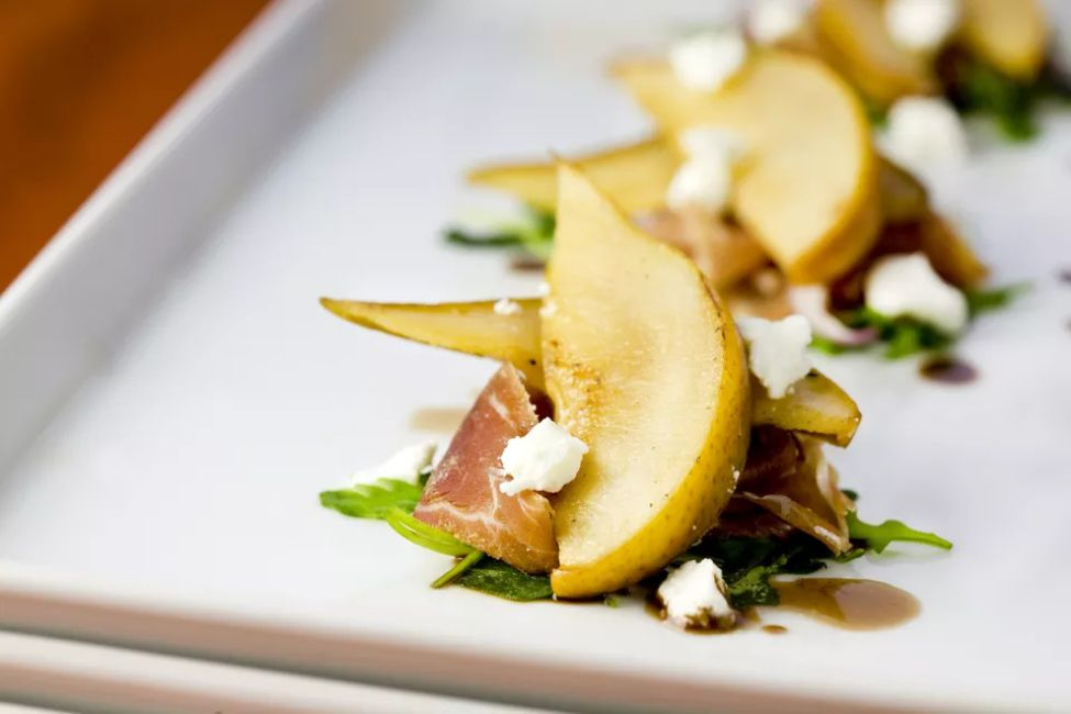 Prosciutto-wrapped pears with candied balsamic drizzle