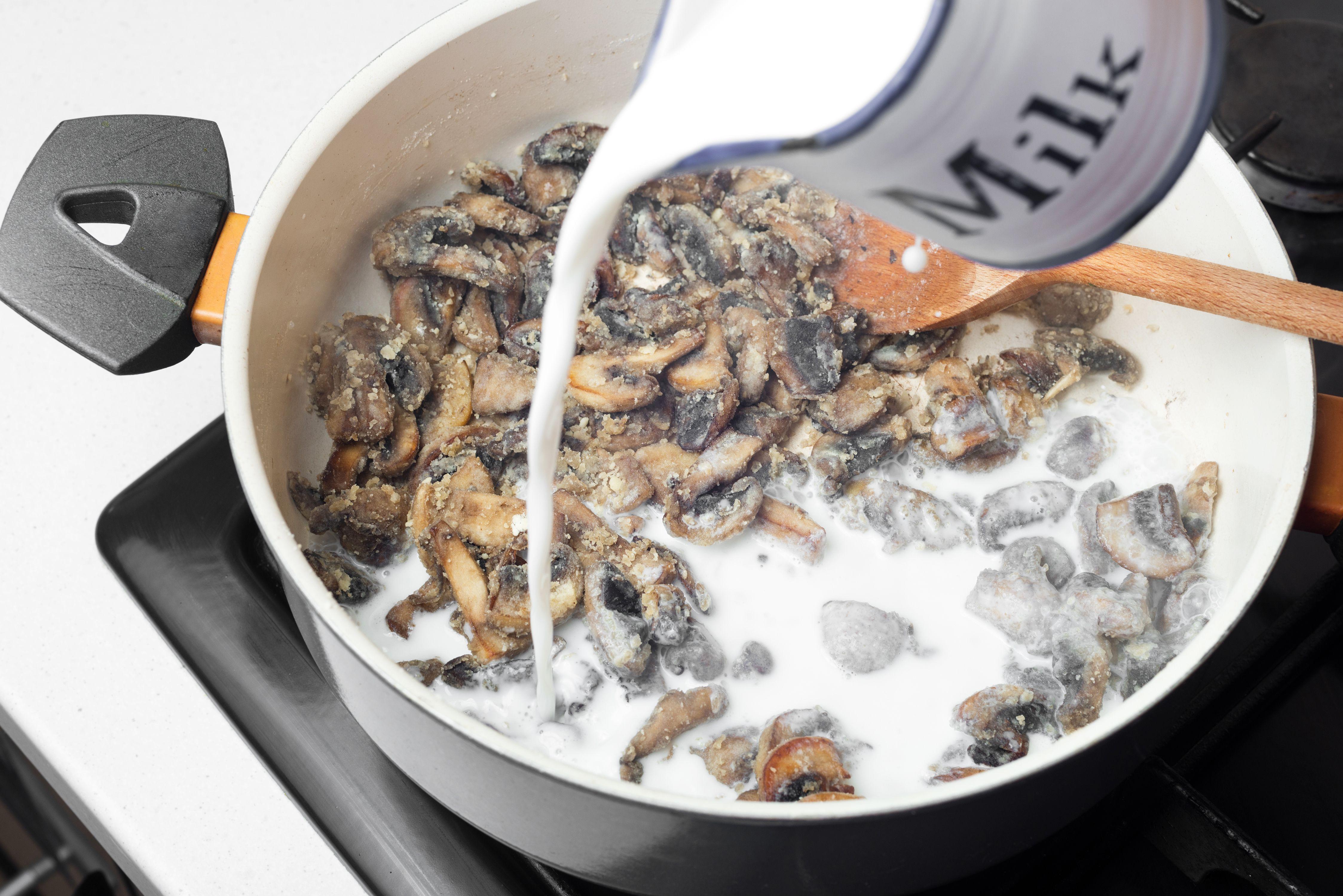 Add milk to flour and mushrooms