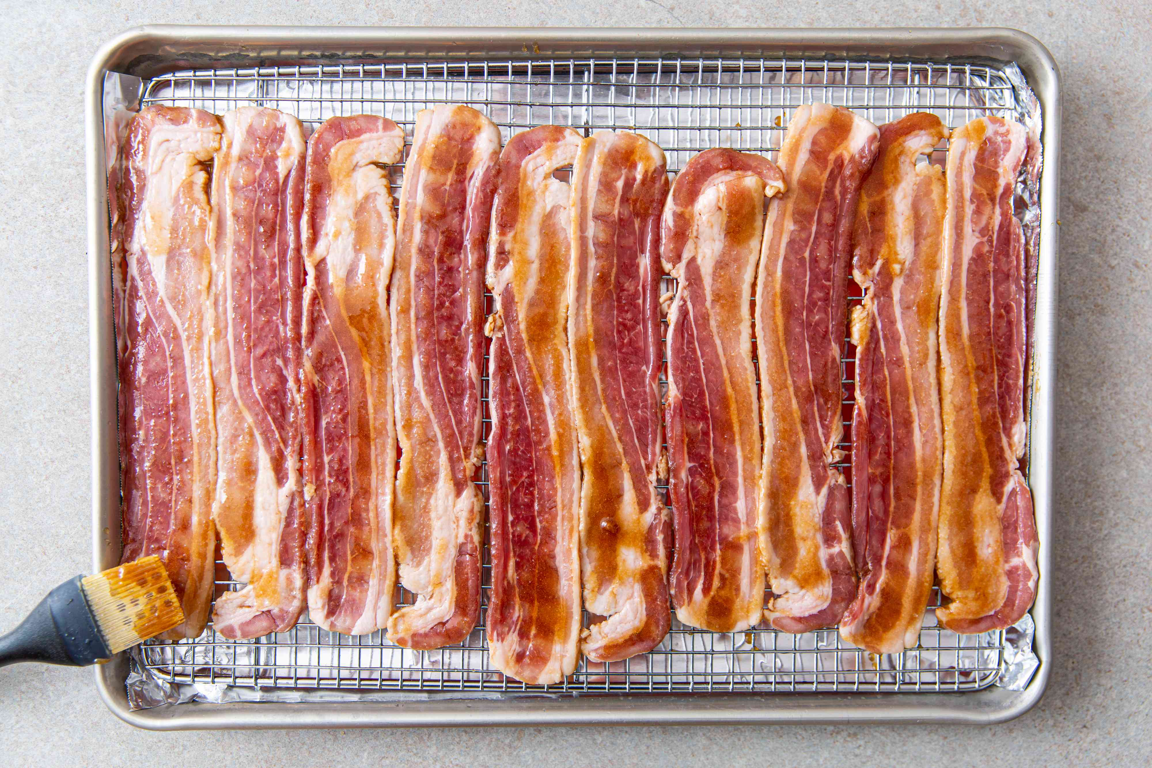 Raw bacon covered with maple syrup and brown sugar