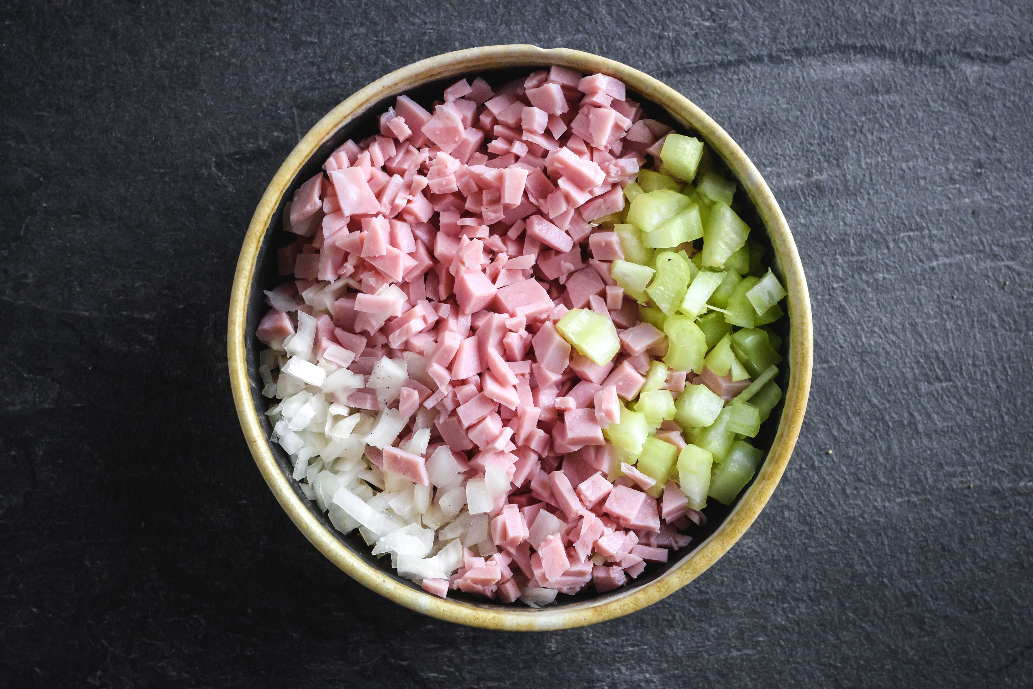 Mix together ham, celery, onion