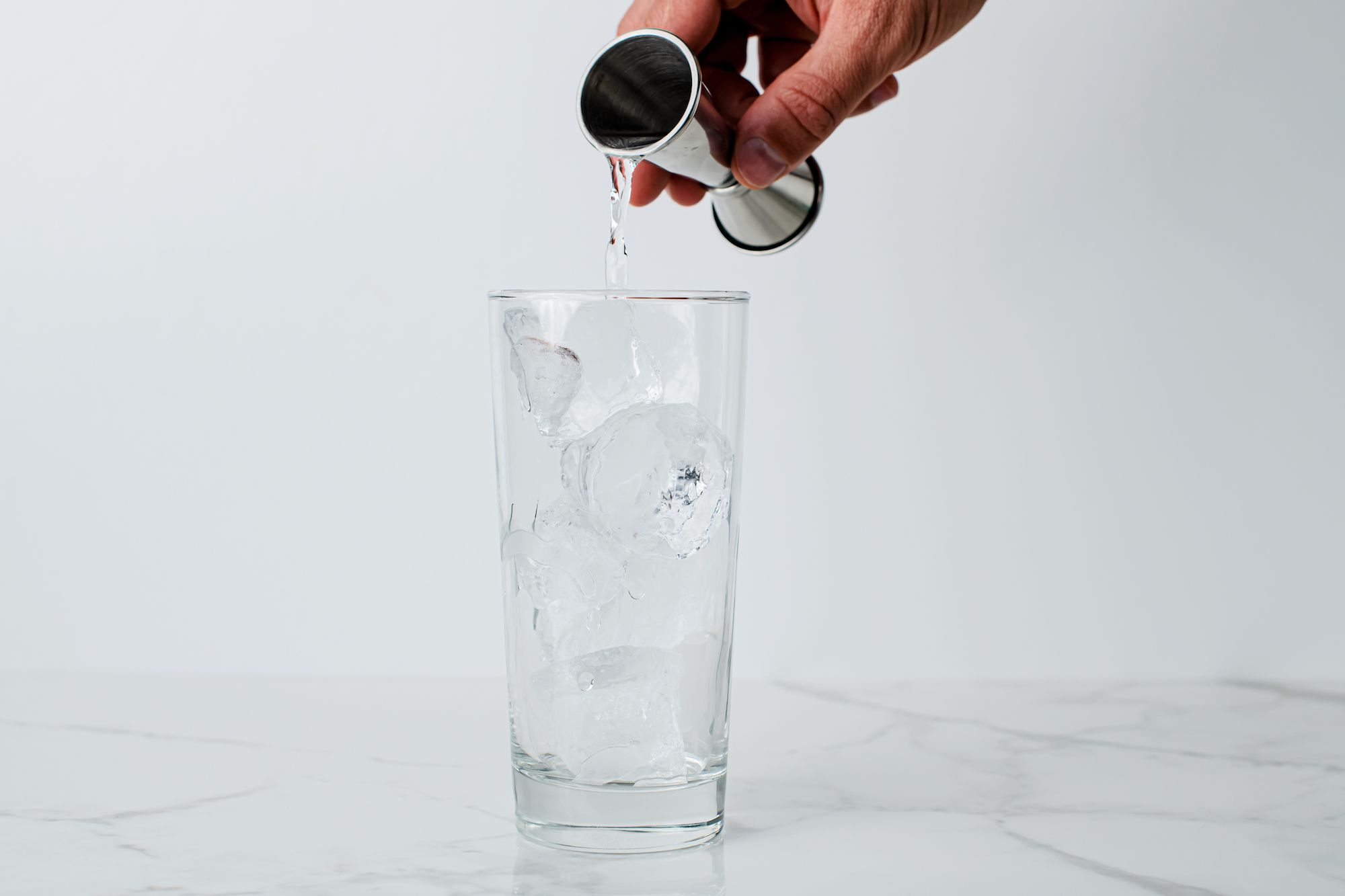 Gin poured into a glass with ice