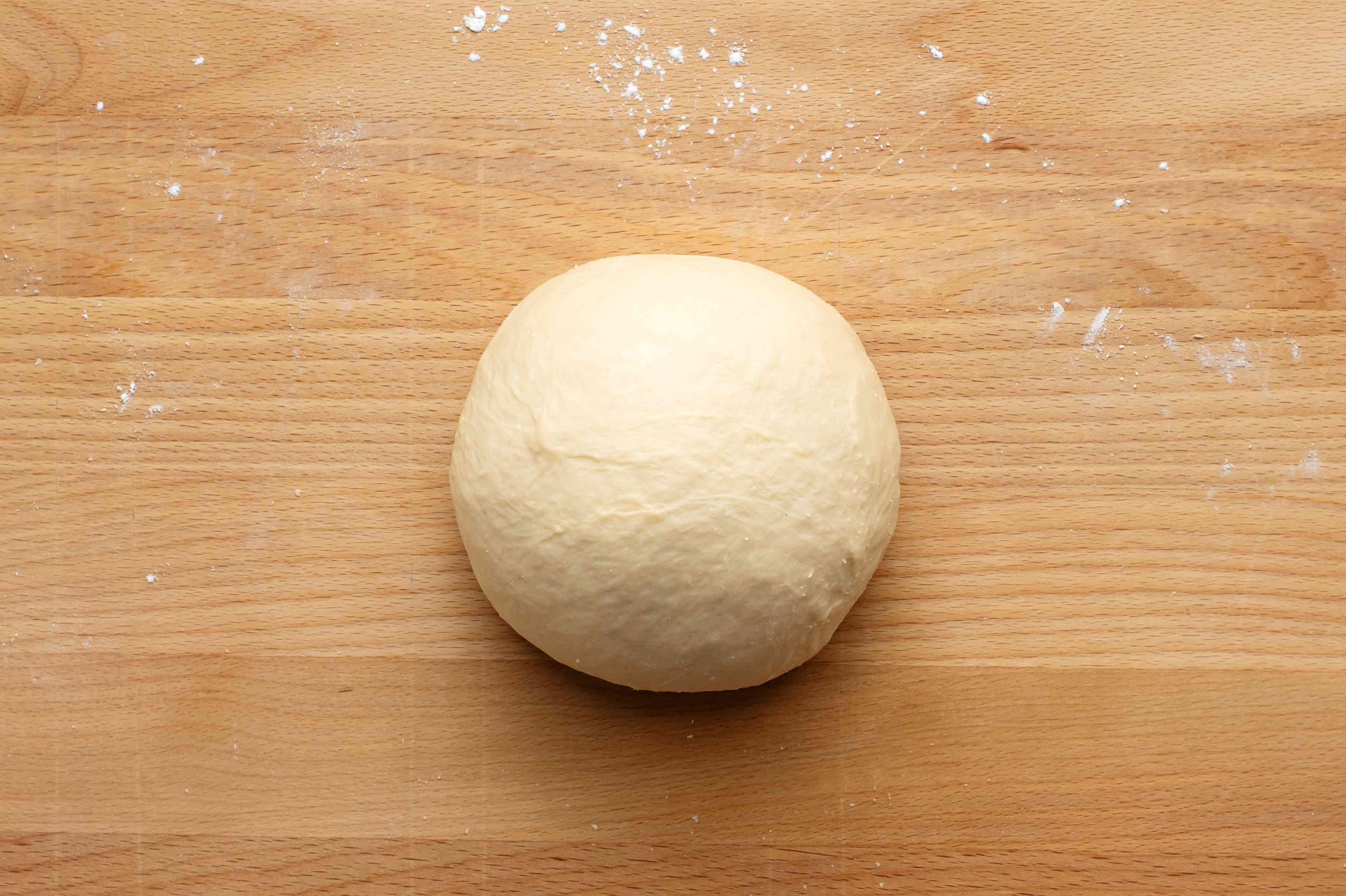 dough ball on a wood board