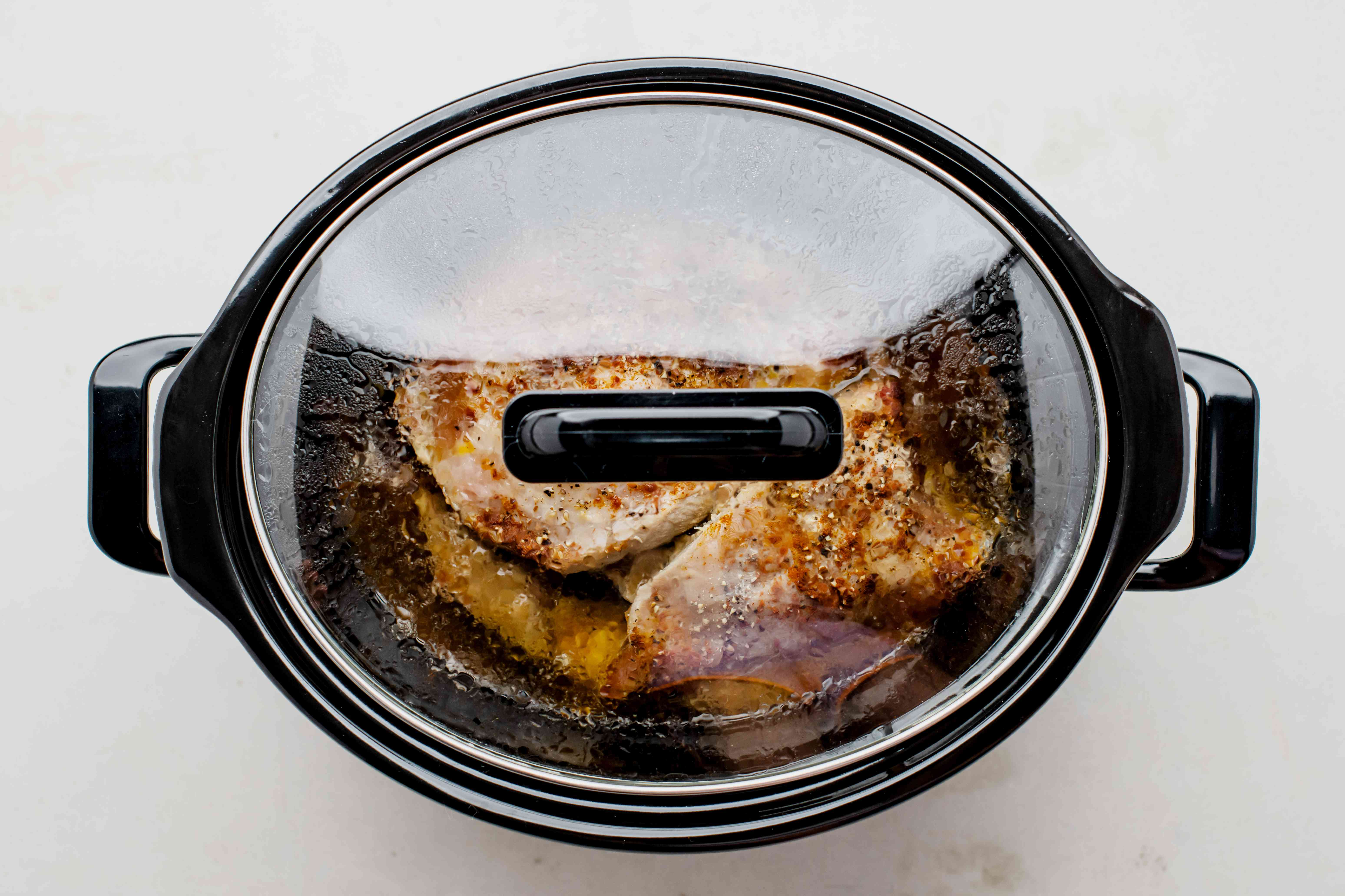Pork in slow cooker with lid on
