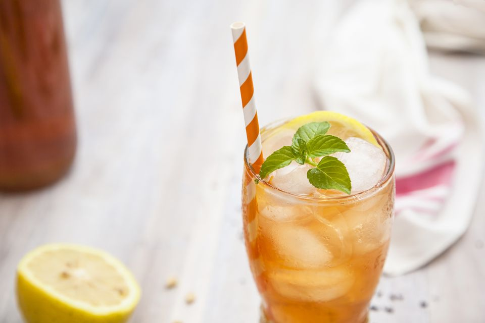 Glass of iced tea with mint and lemon