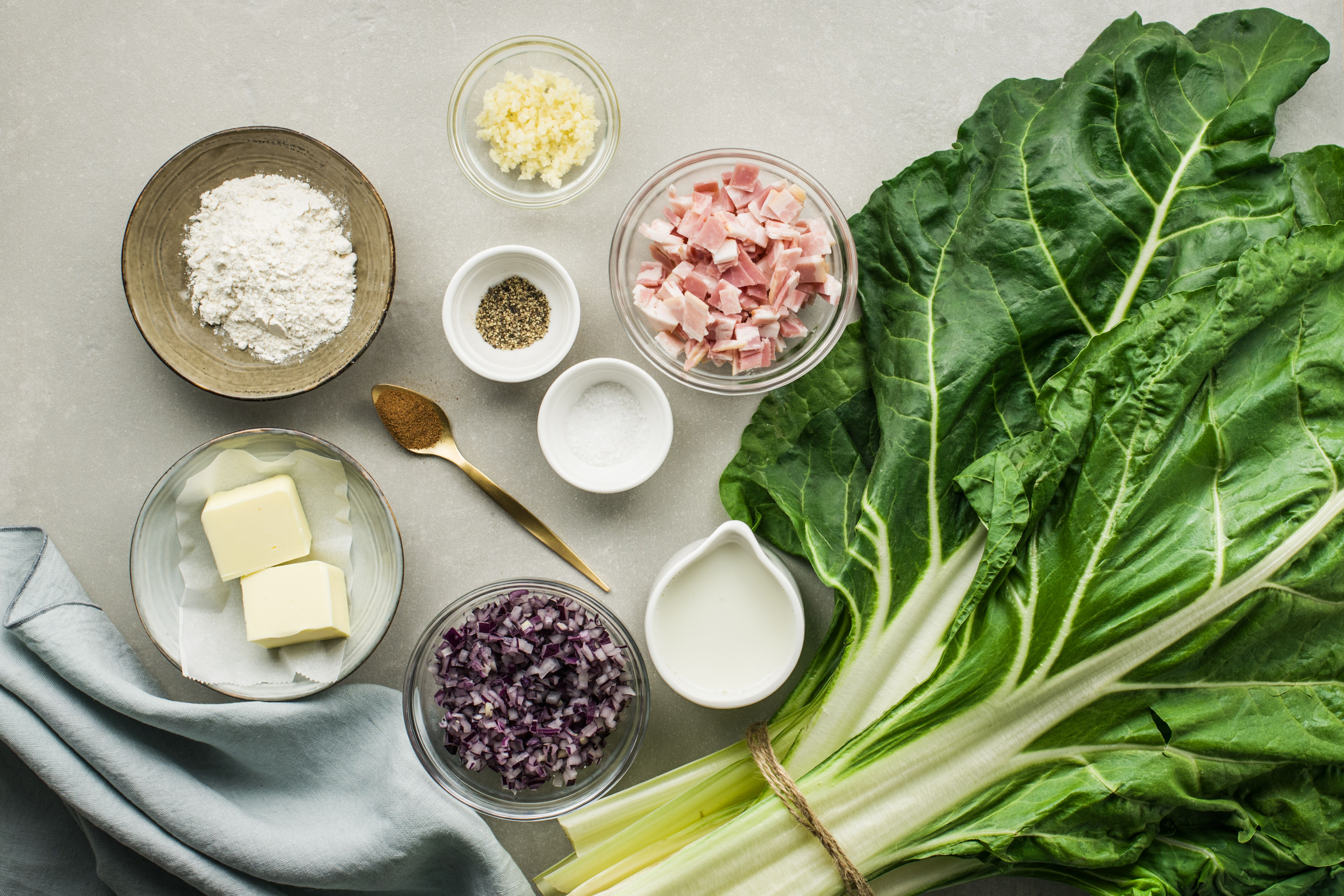 Ingredients for creamed swiss chard with bacon