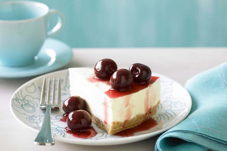 Black cherry cheesecake slice on a plate