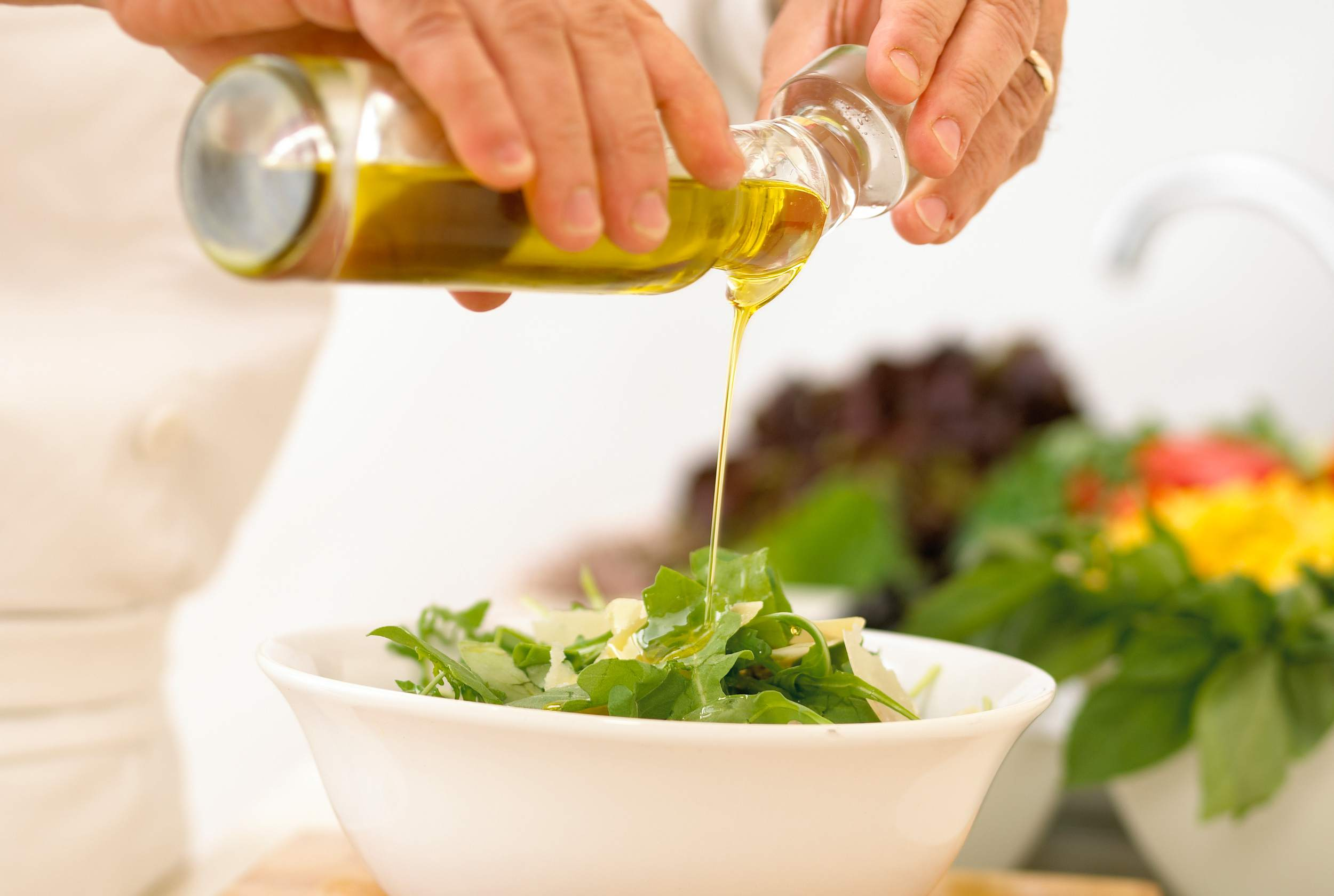 Pouring dressing over salad