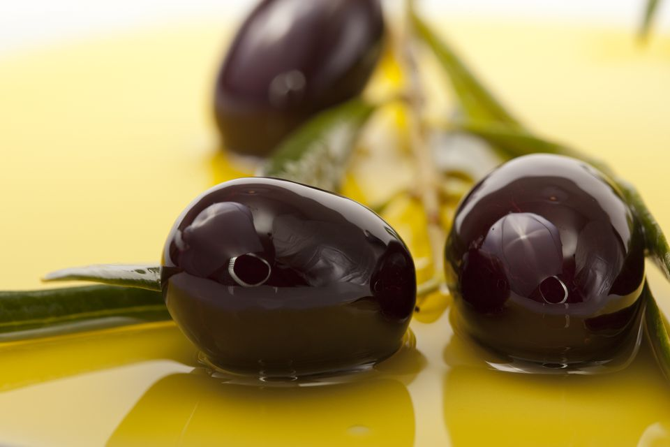 Black Olives in olive oil background