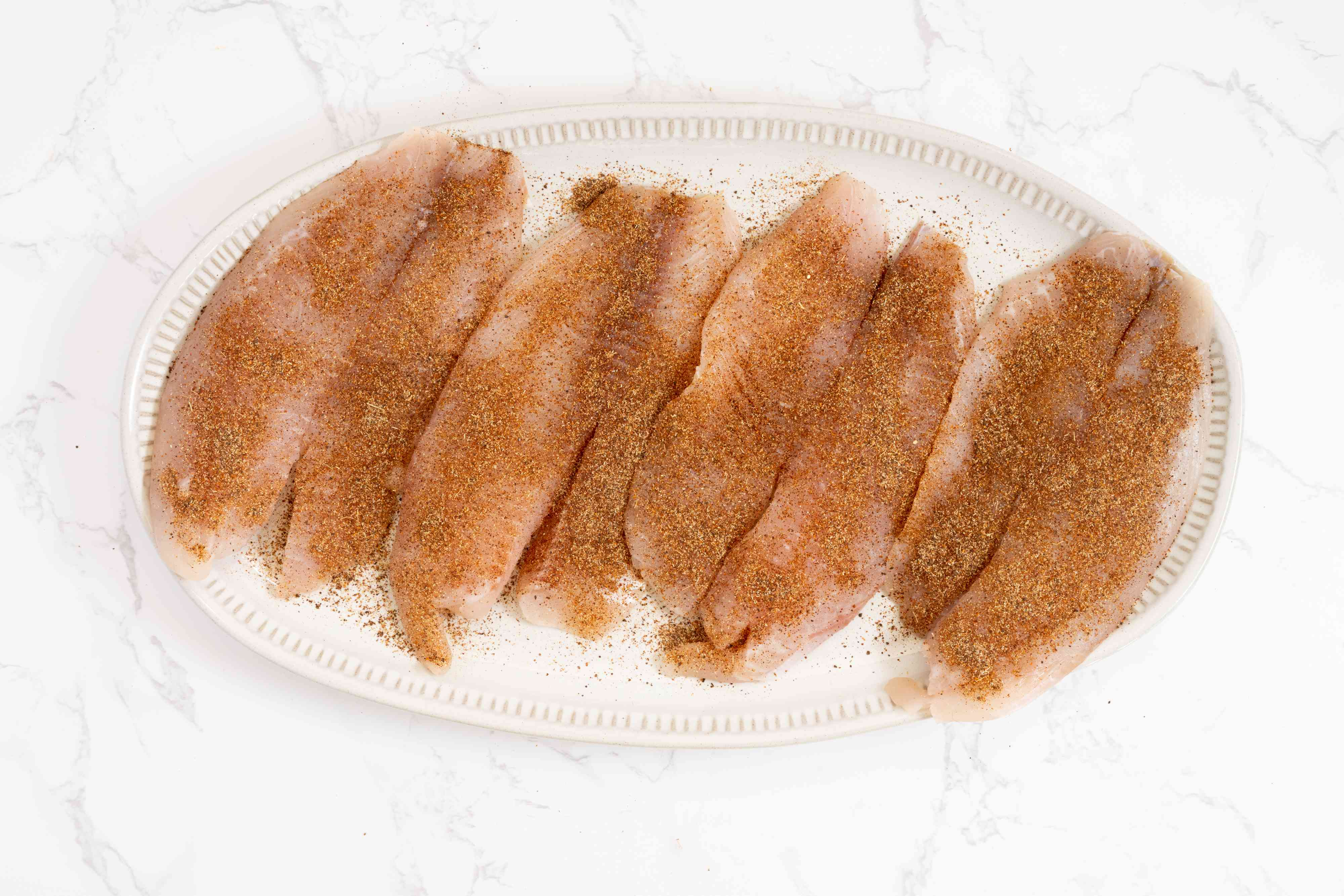 Sprinkle the spice mixture over both sides of the tilapia fillets