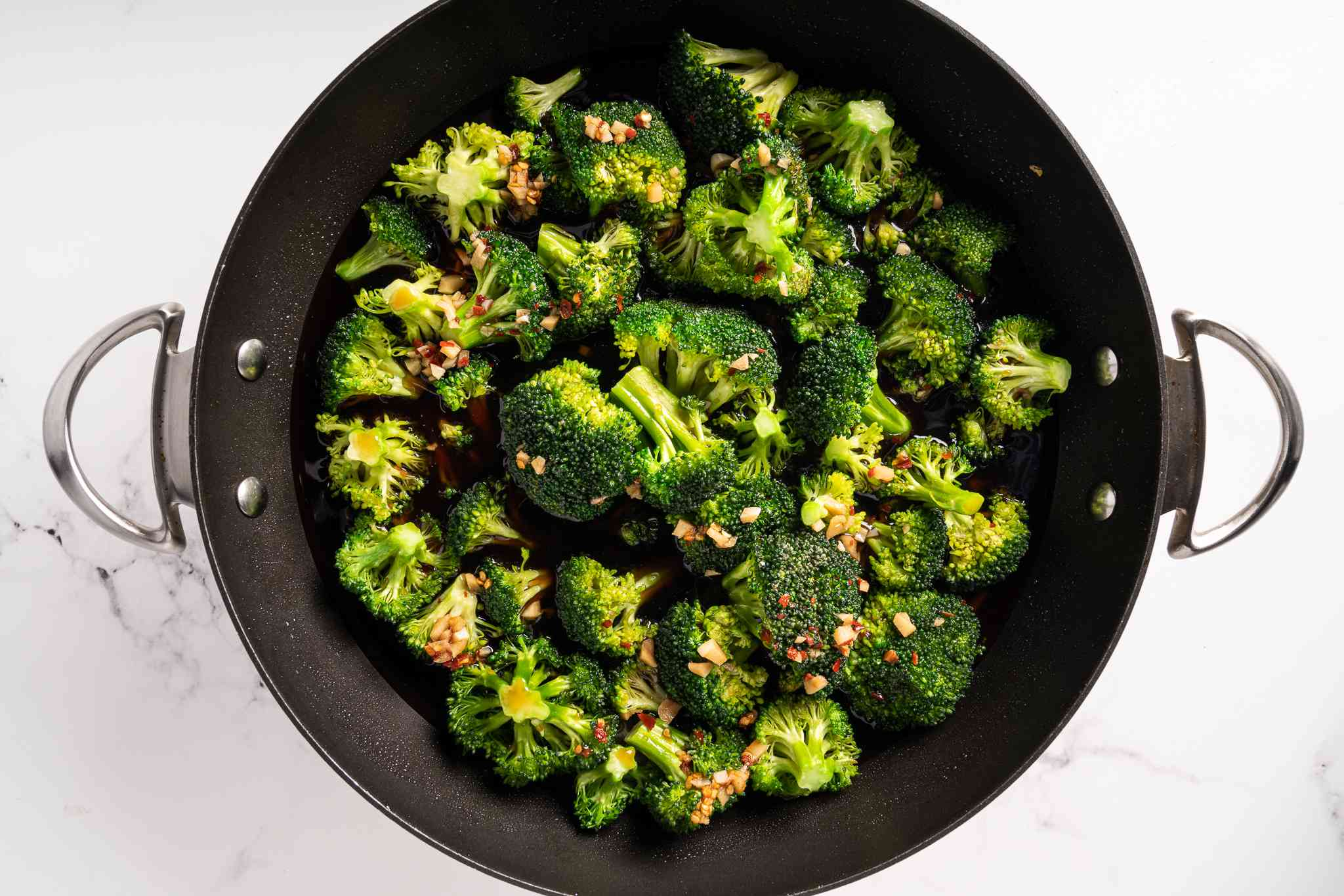add vegetable broth mixture to the broccoli in the pan