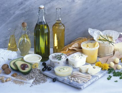 A sporgasbord of oils, butters, and fatty foods representing different types of fats