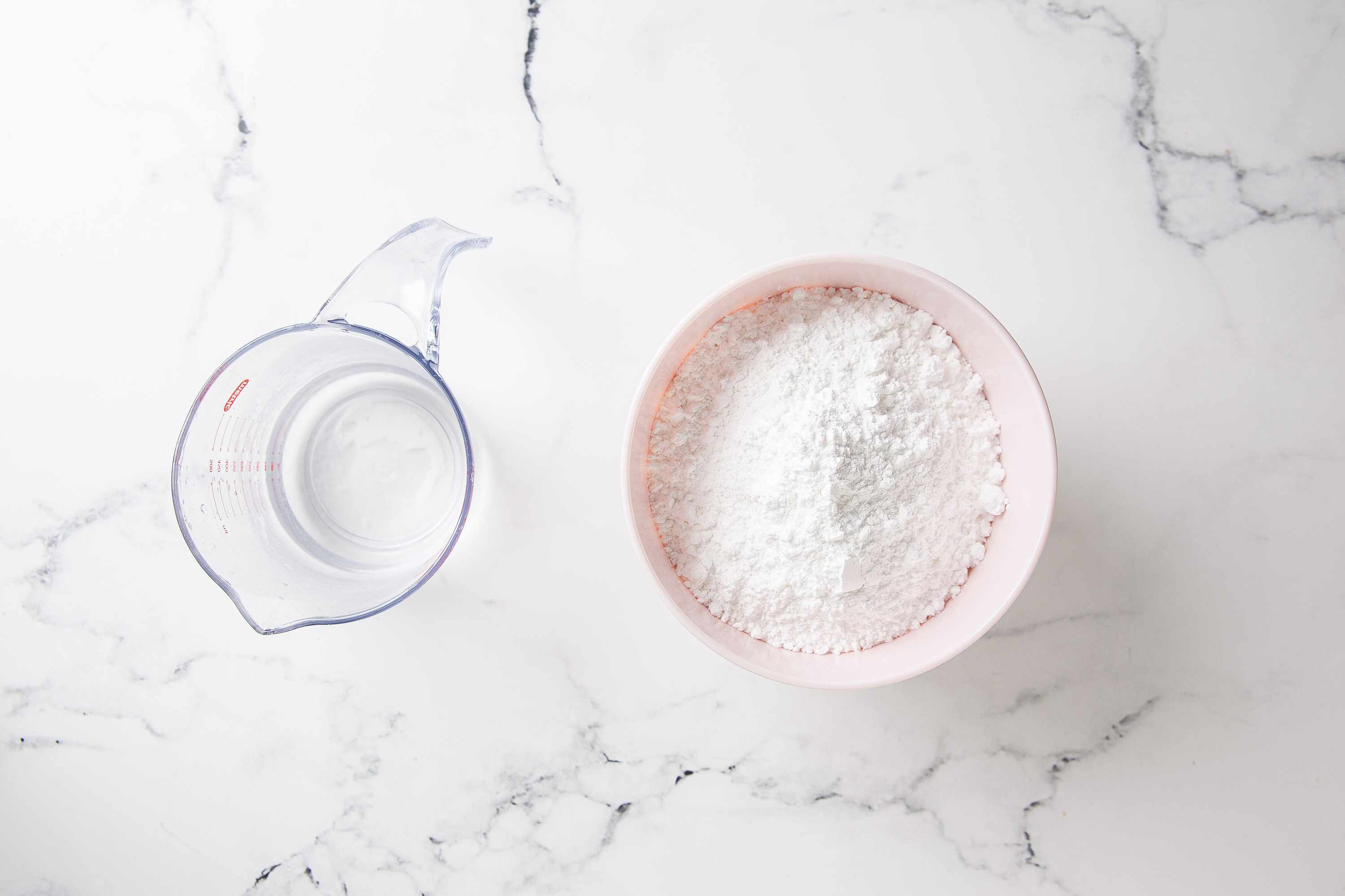 Combine water and powdered sugar