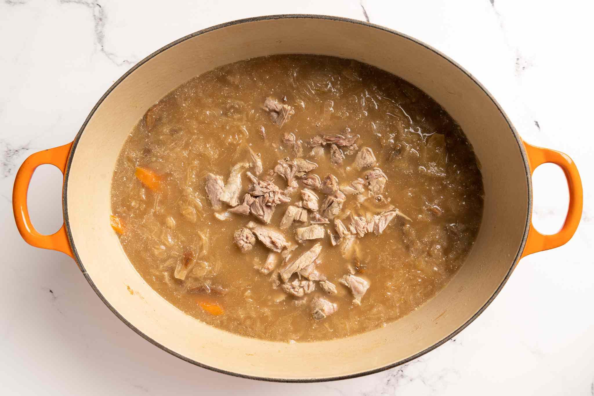 Ukrainian Sauerkraut Soup (Kapusnyak) in a Dutch oven