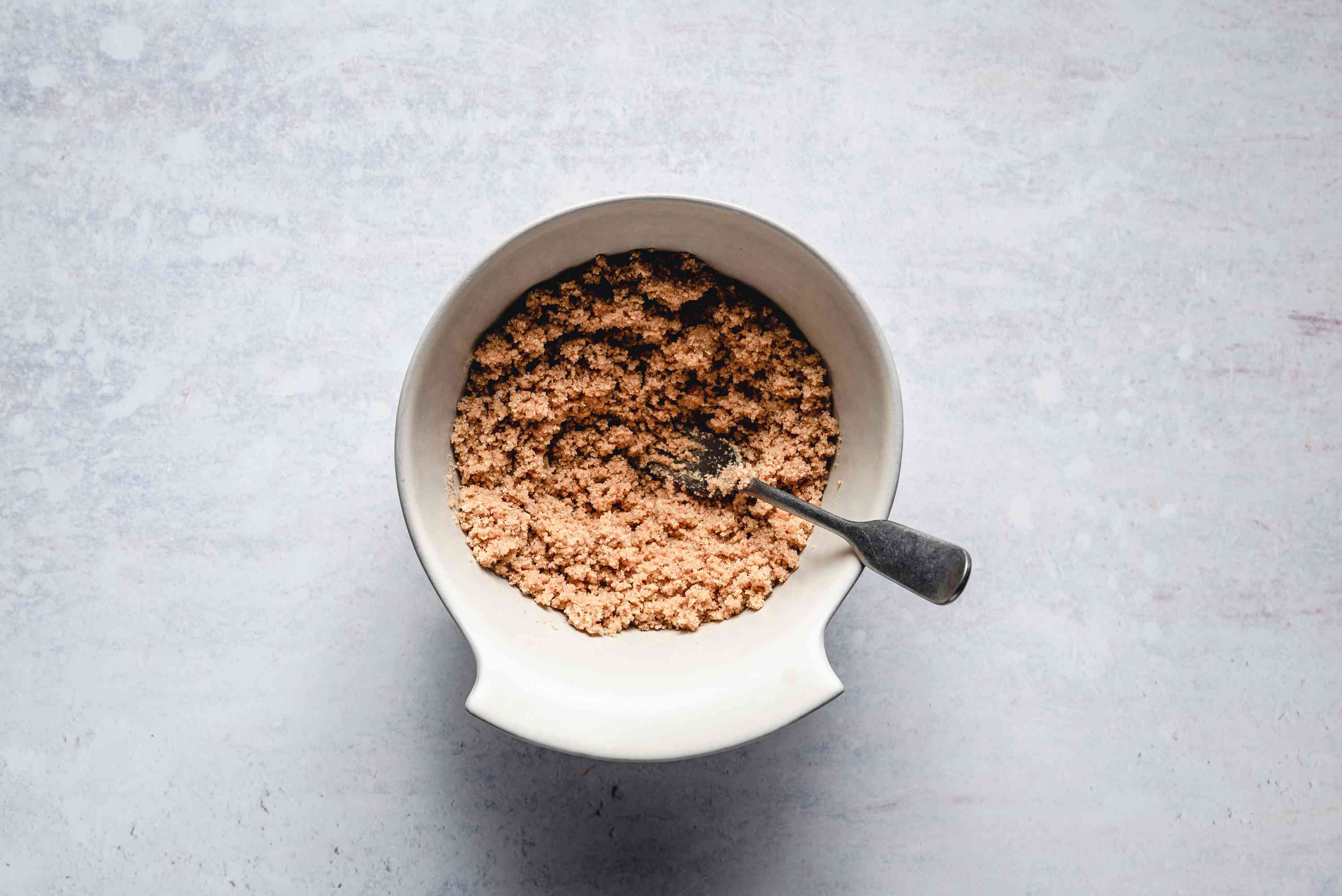 graham cracker crumbs and melted butter mashed together in a bowl