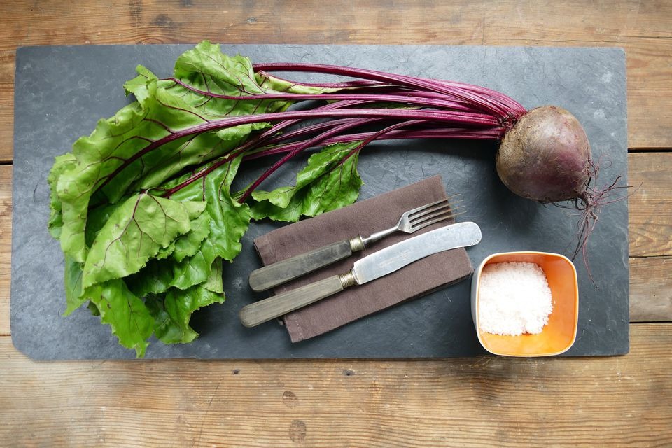 Common beet on slate over table