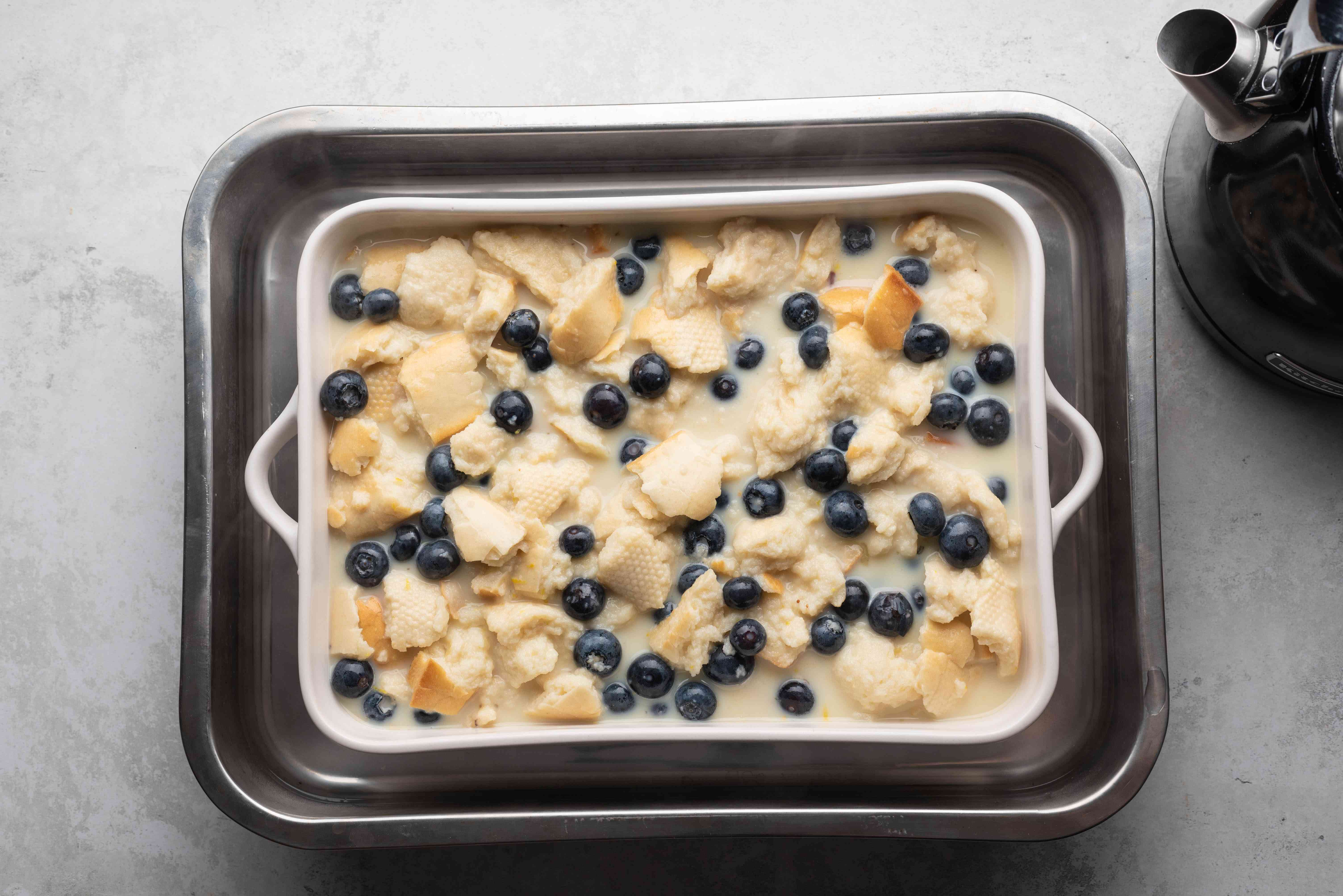 bread pudding in a baking dish in a water bath