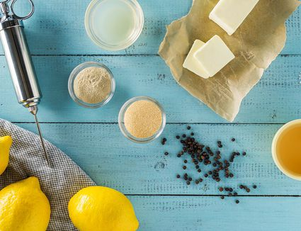 Butter-based injection ingredients on blue wood table