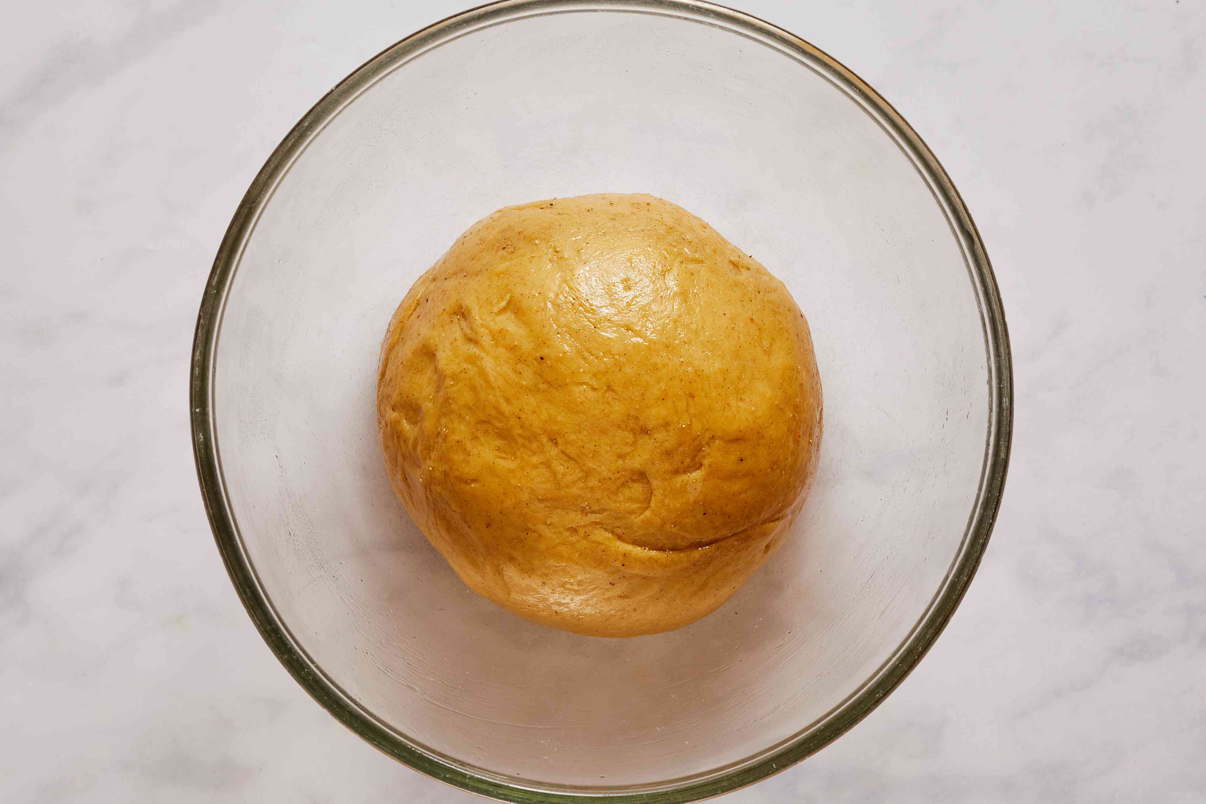 dough in a ball in a greased bowl