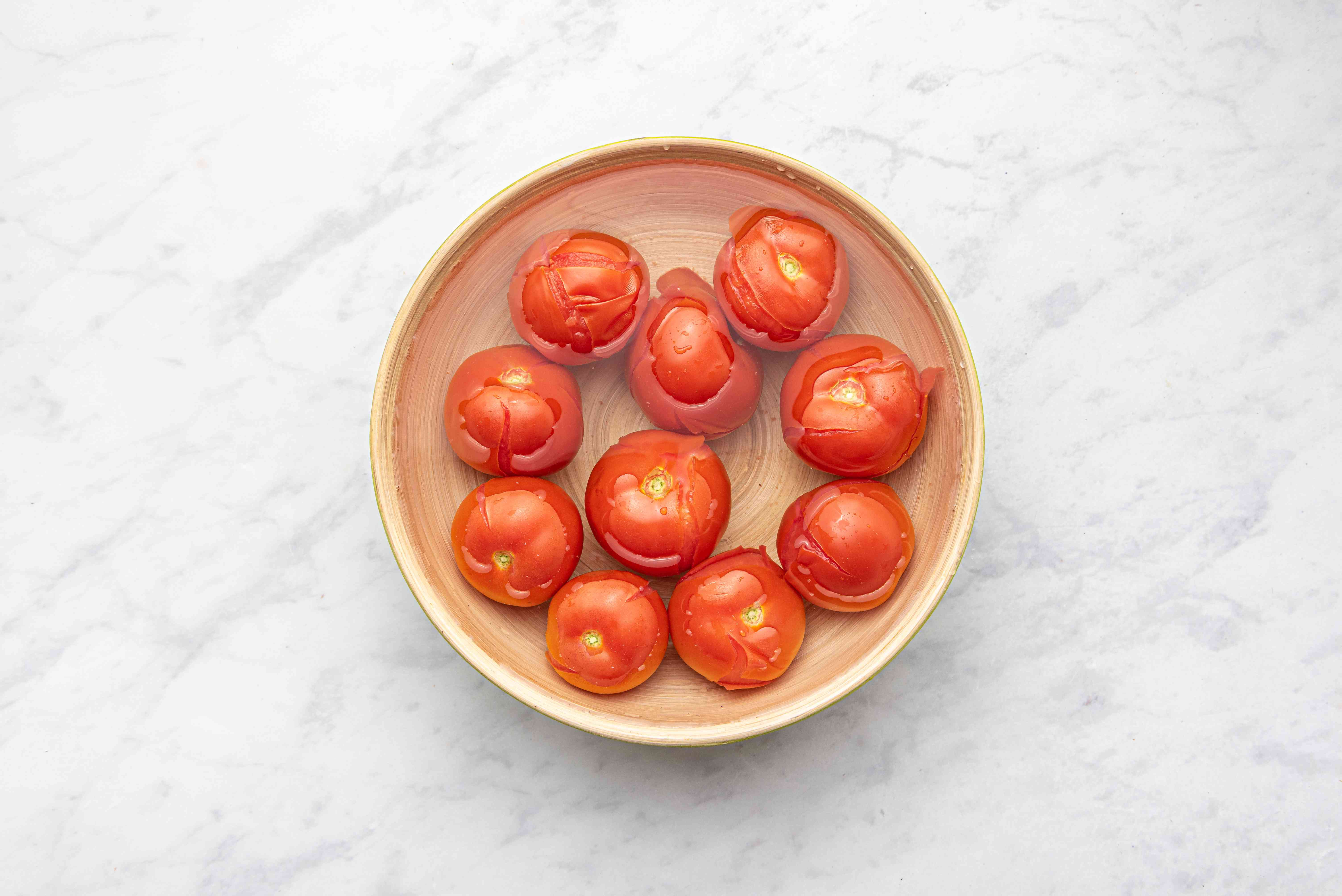Tomatoes in a bowl of ice water