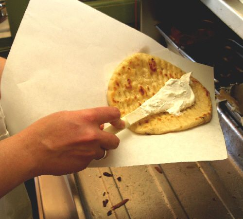 Put a healthy helping of tzatziki on the pita bread
